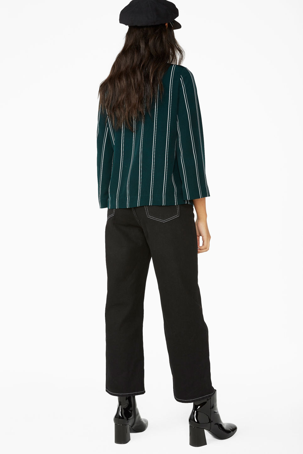 Model back image of Monki silky wrap blouse in green