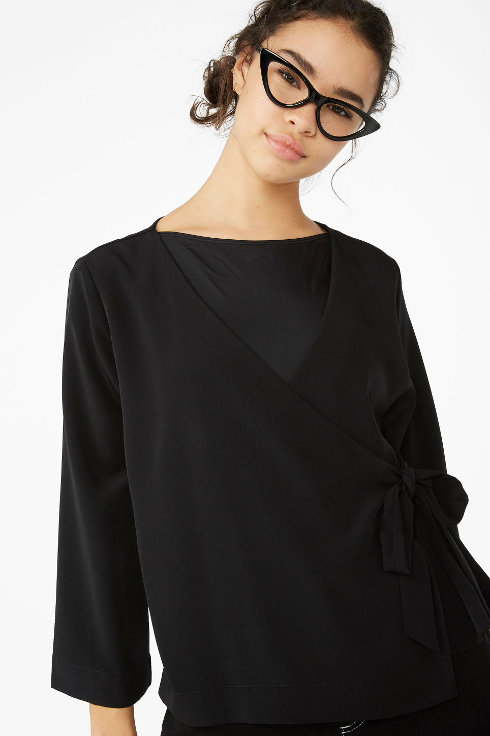 Model front image of Monki silky wrap blouse in black