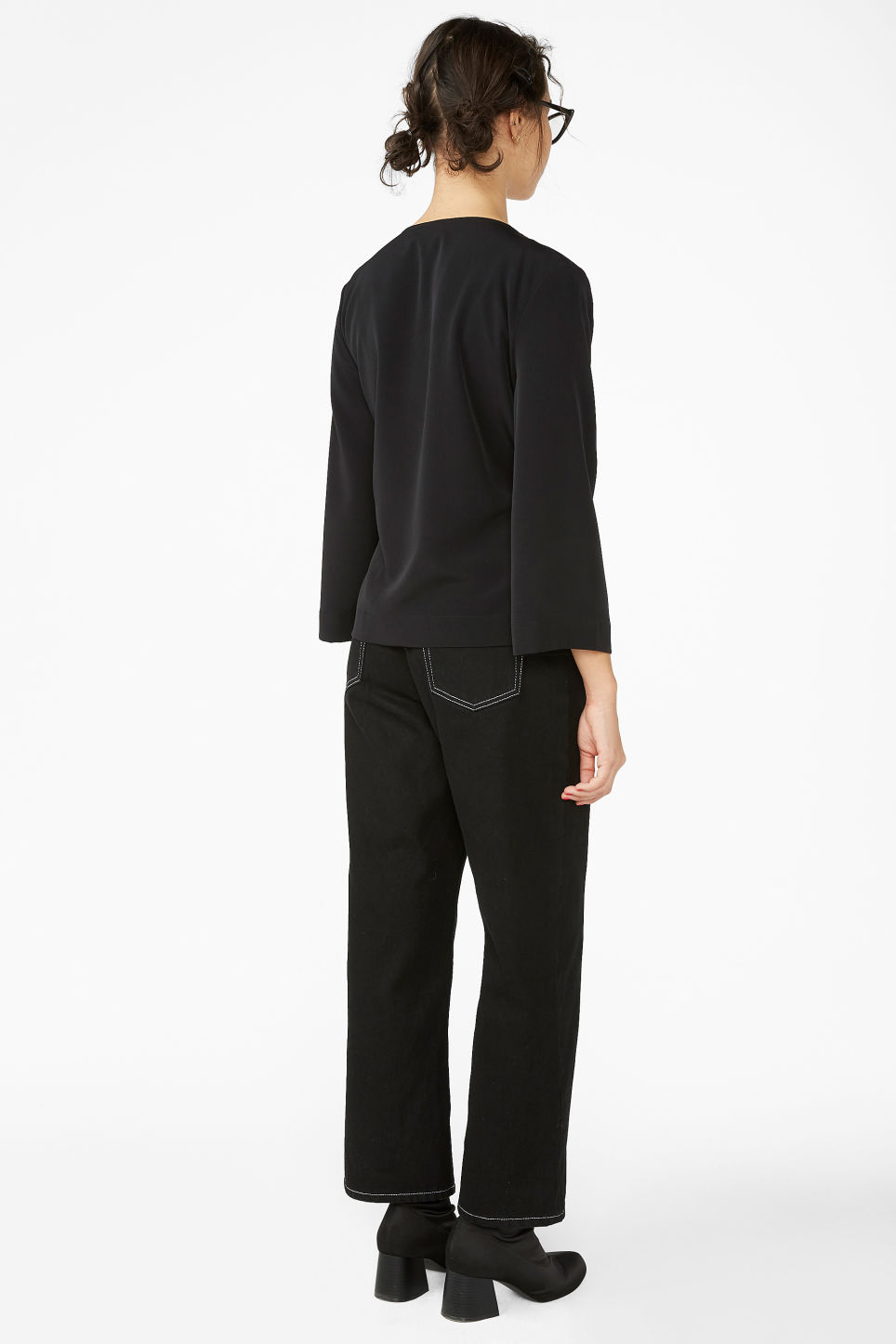 Model back image of Monki silky wrap blouse in black