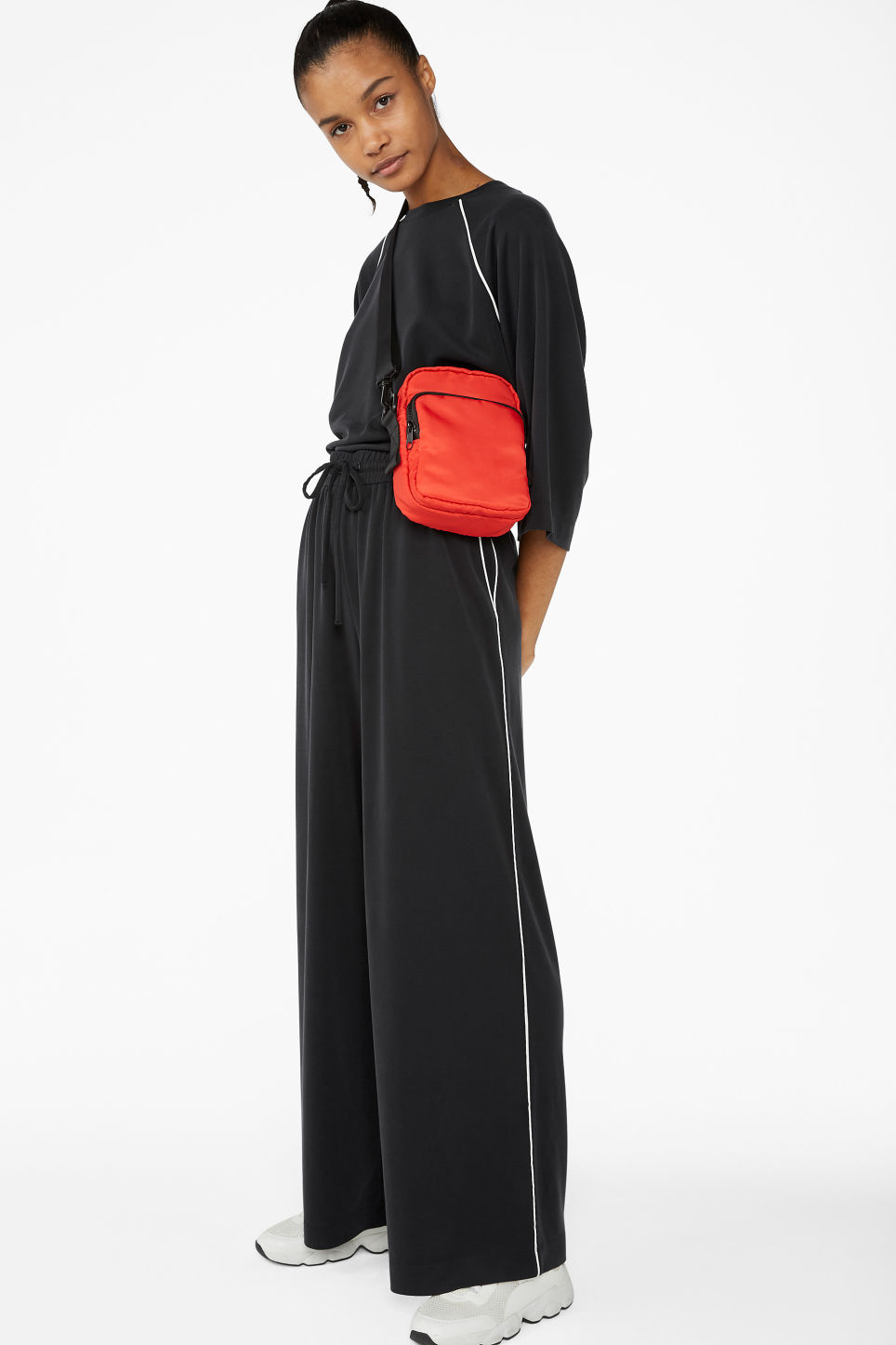 Model front image of Monki super-soft trousers with contrast piping in black