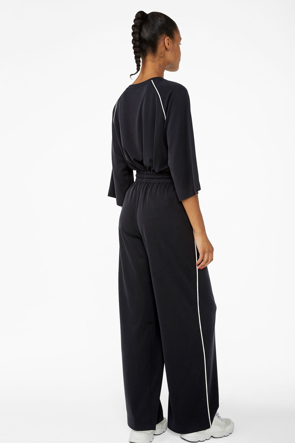 Model back image of Monki super-soft trousers with contrast piping in black