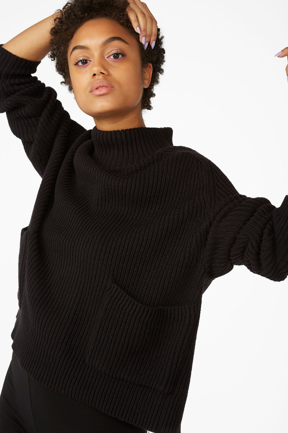 Model front image of Monki knitted turtleneck top in black