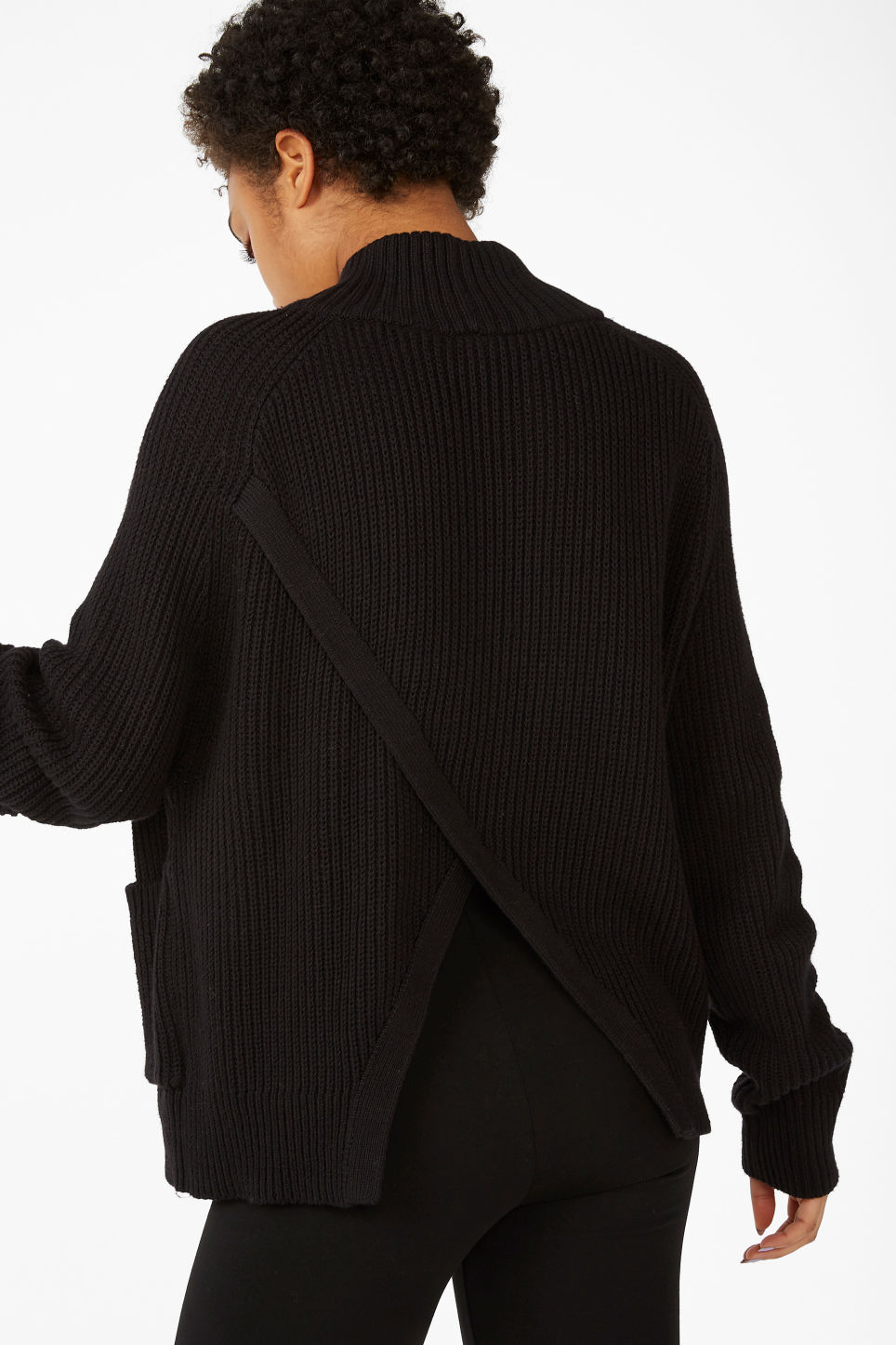 Model back image of Monki knitted turtleneck top in black