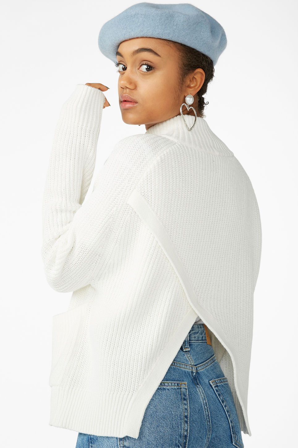 Model front image of Monki knitted turtleneck top in white