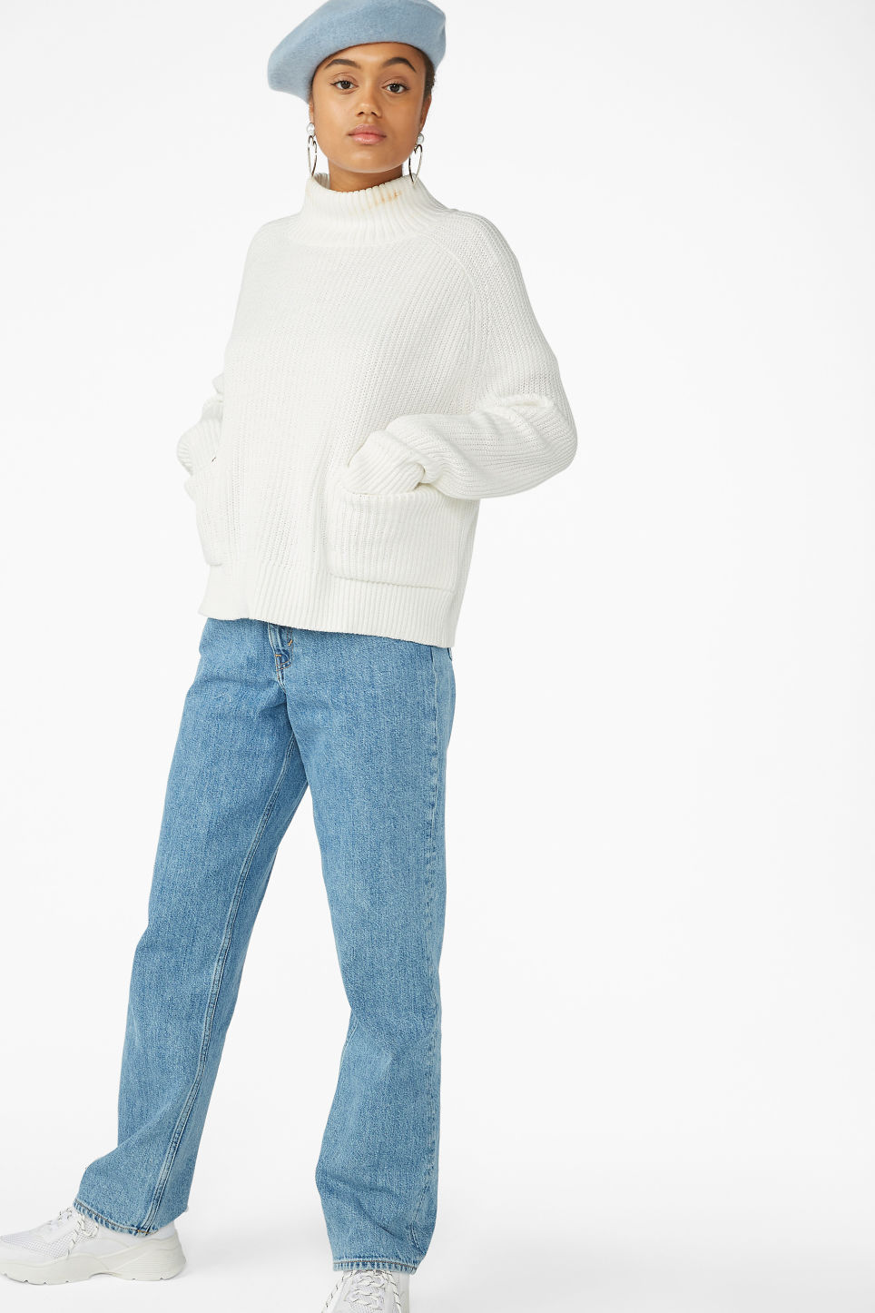 Model side image of Monki knitted turtleneck top in white