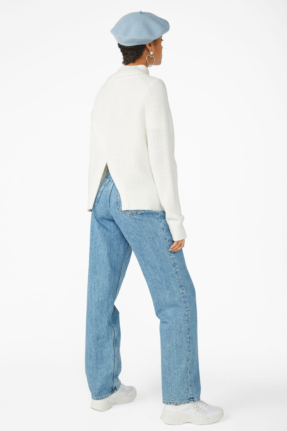 Model back image of Monki knitted turtleneck top in white
