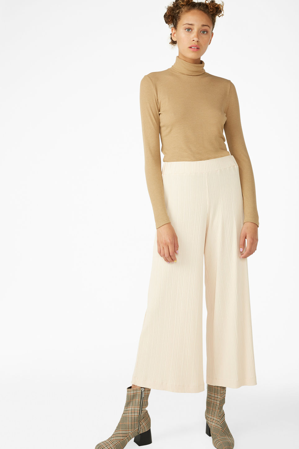 Model front image of Monki ribbed turtleneck top in beige