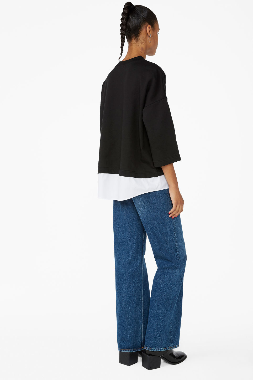 Model back image of Monki sweater with attached blouse hemline in black