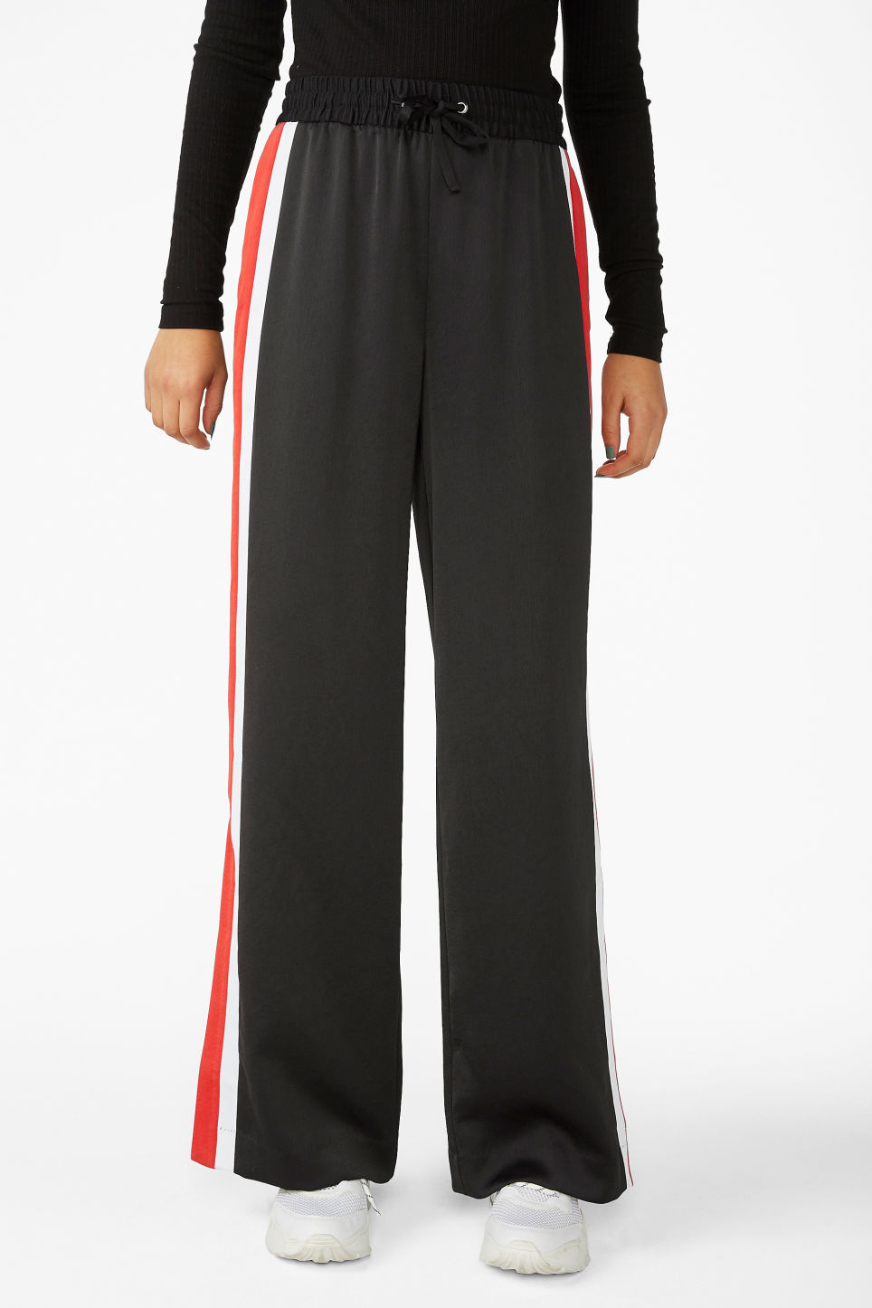 Model side image of Monki tracksuit pants in black