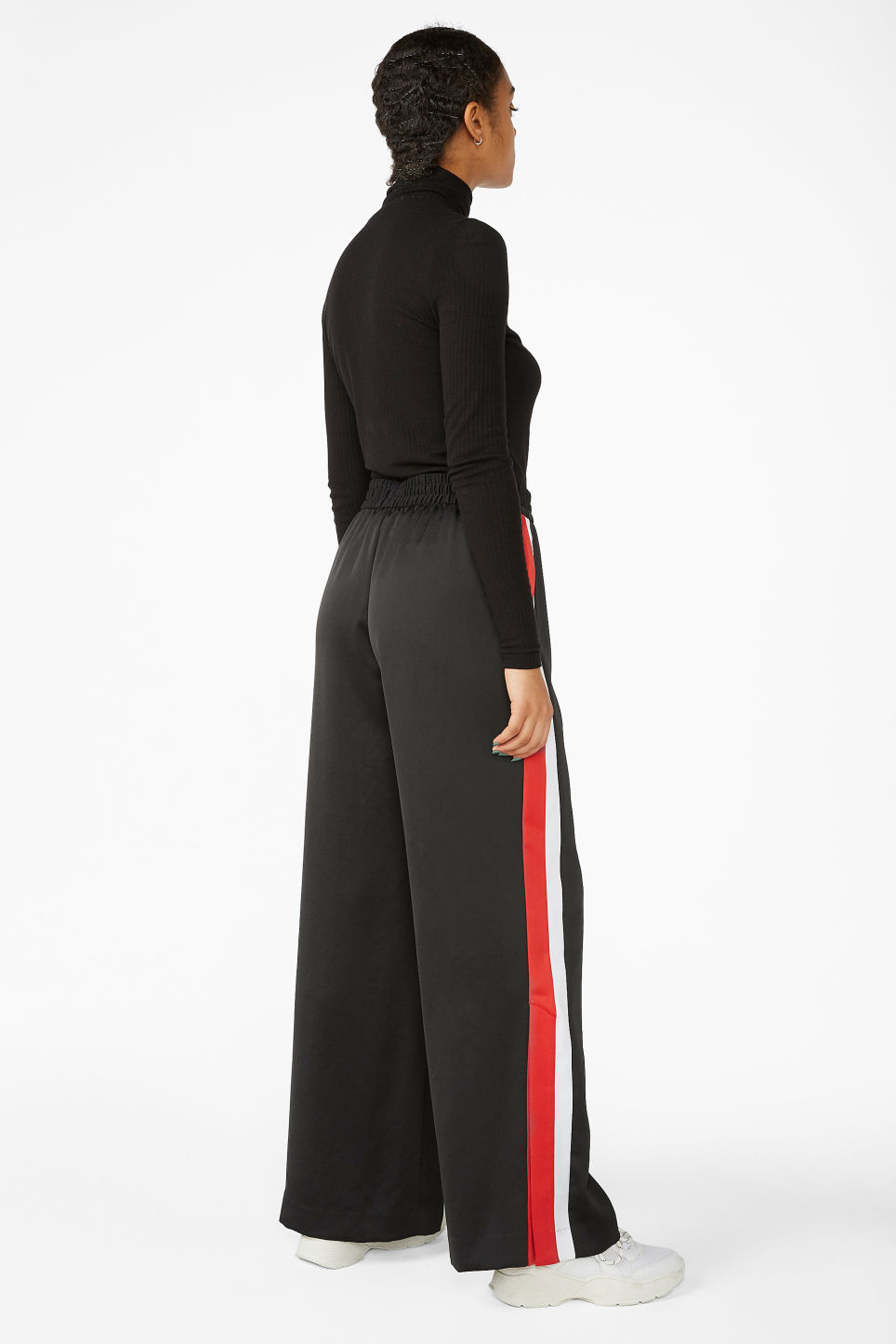 Model back image of Monki tracksuit pants in black