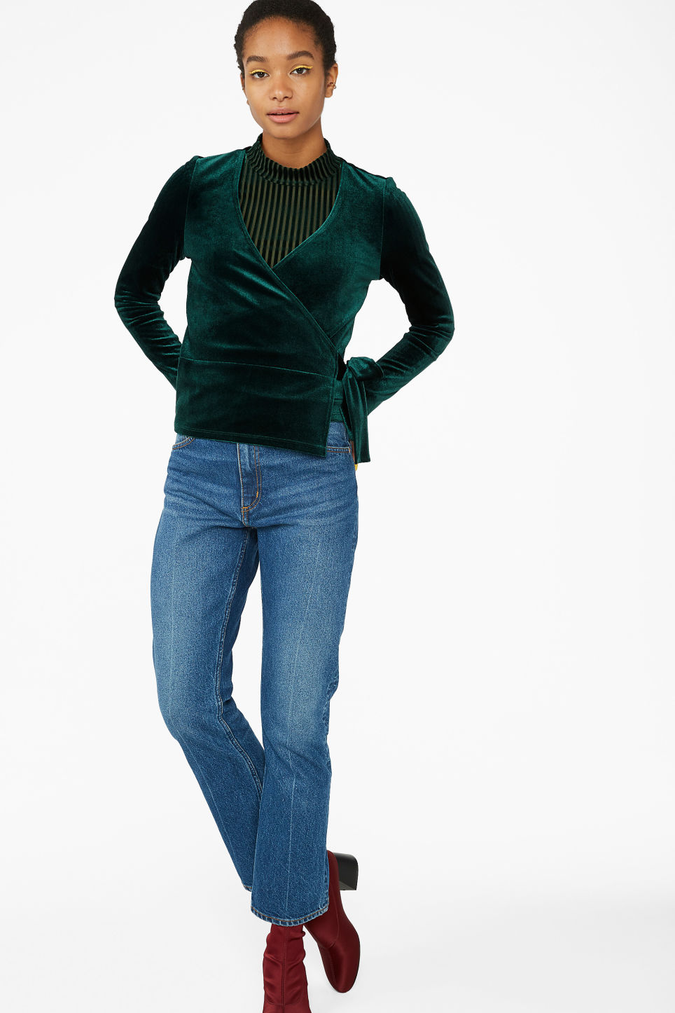 Model side image of Monki velvet wrap top in green