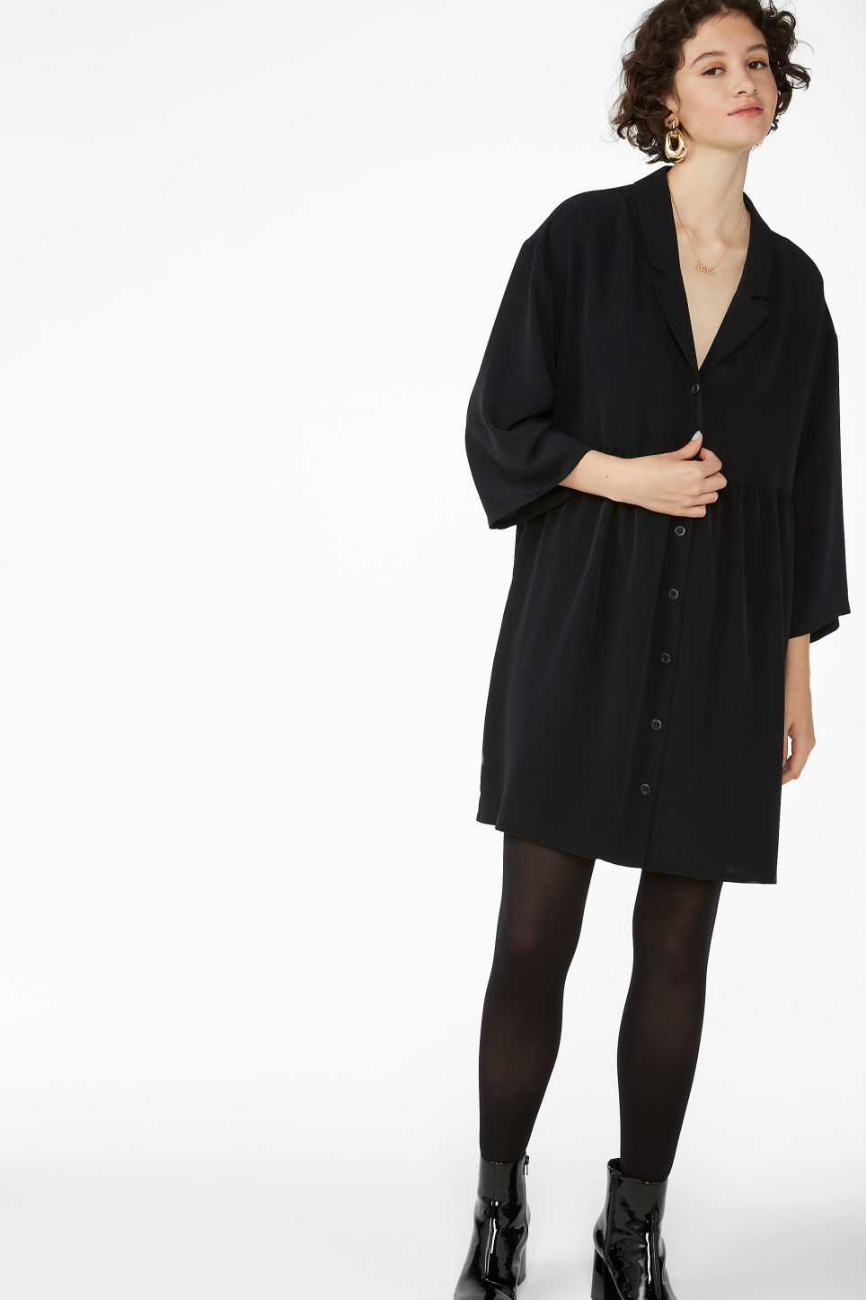 Model front image of Monki flowy buttoned dress in black