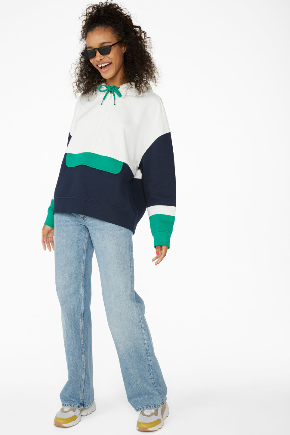Model side image of Monki colour block hoodie in white