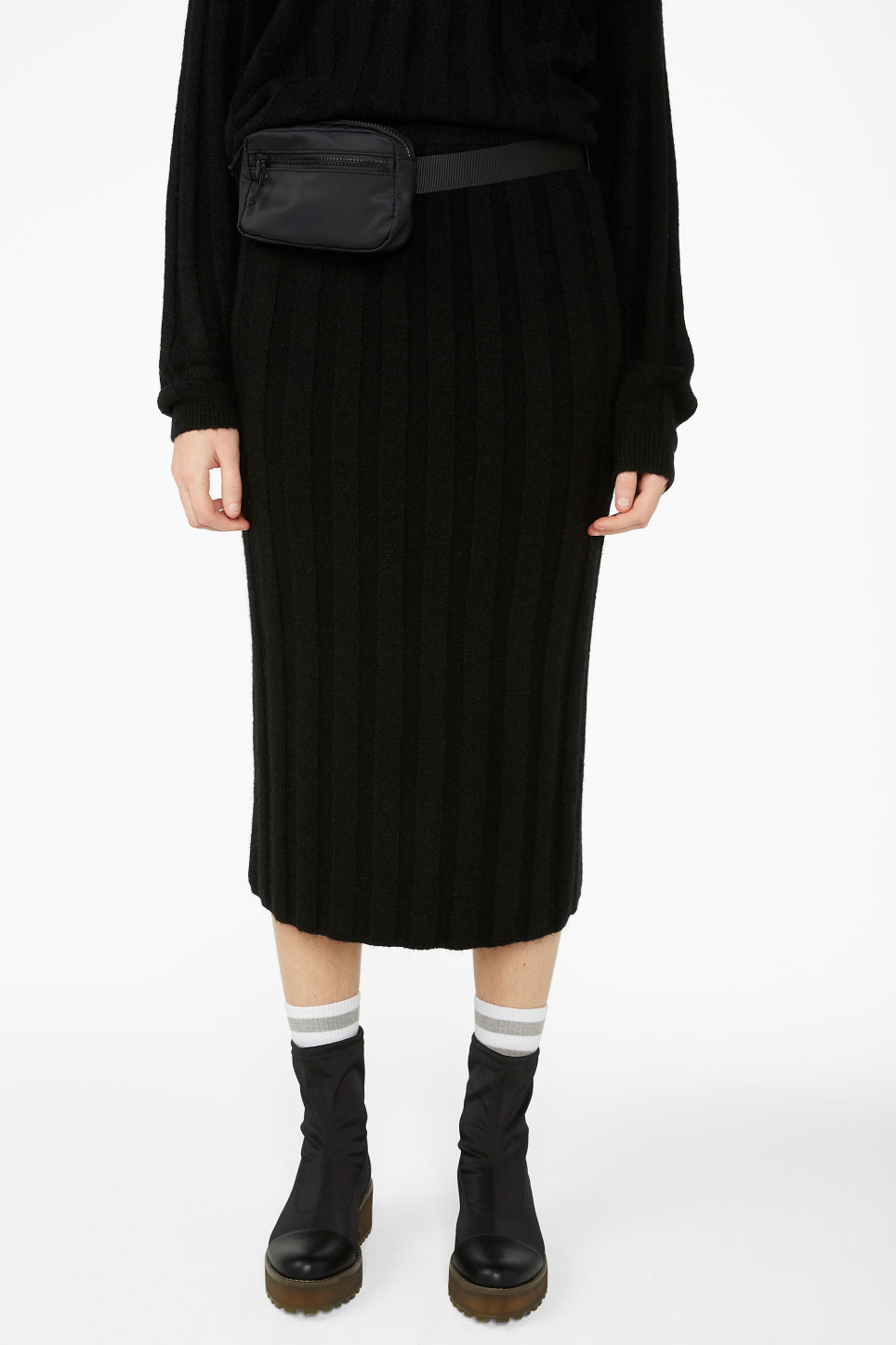 Model side image of Monki ribbed back-slit skirt in black