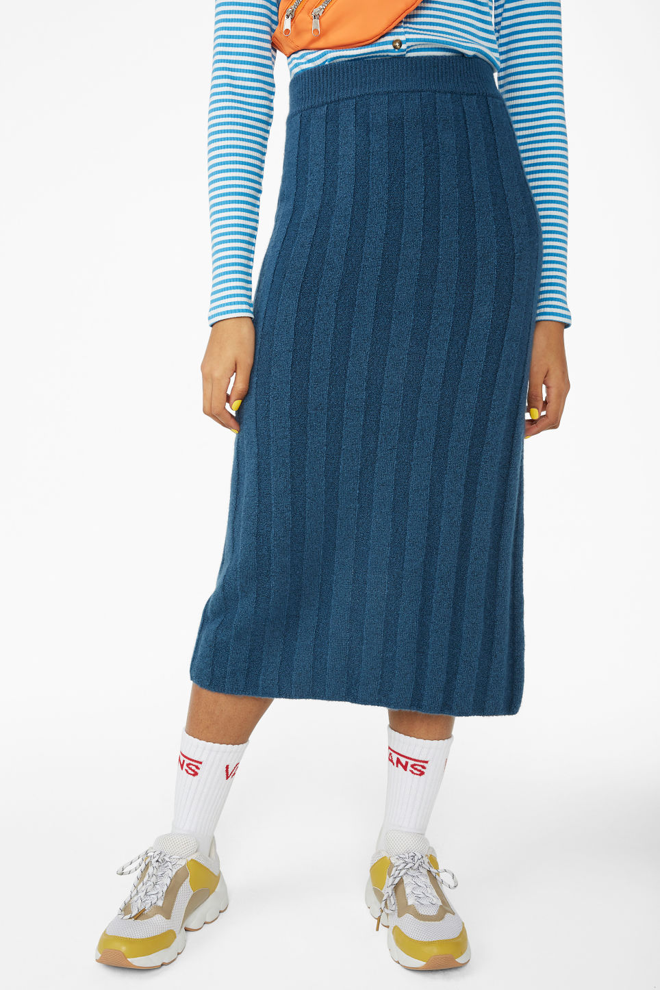 Model side image of Monki ribbed back-slit skirt in blue