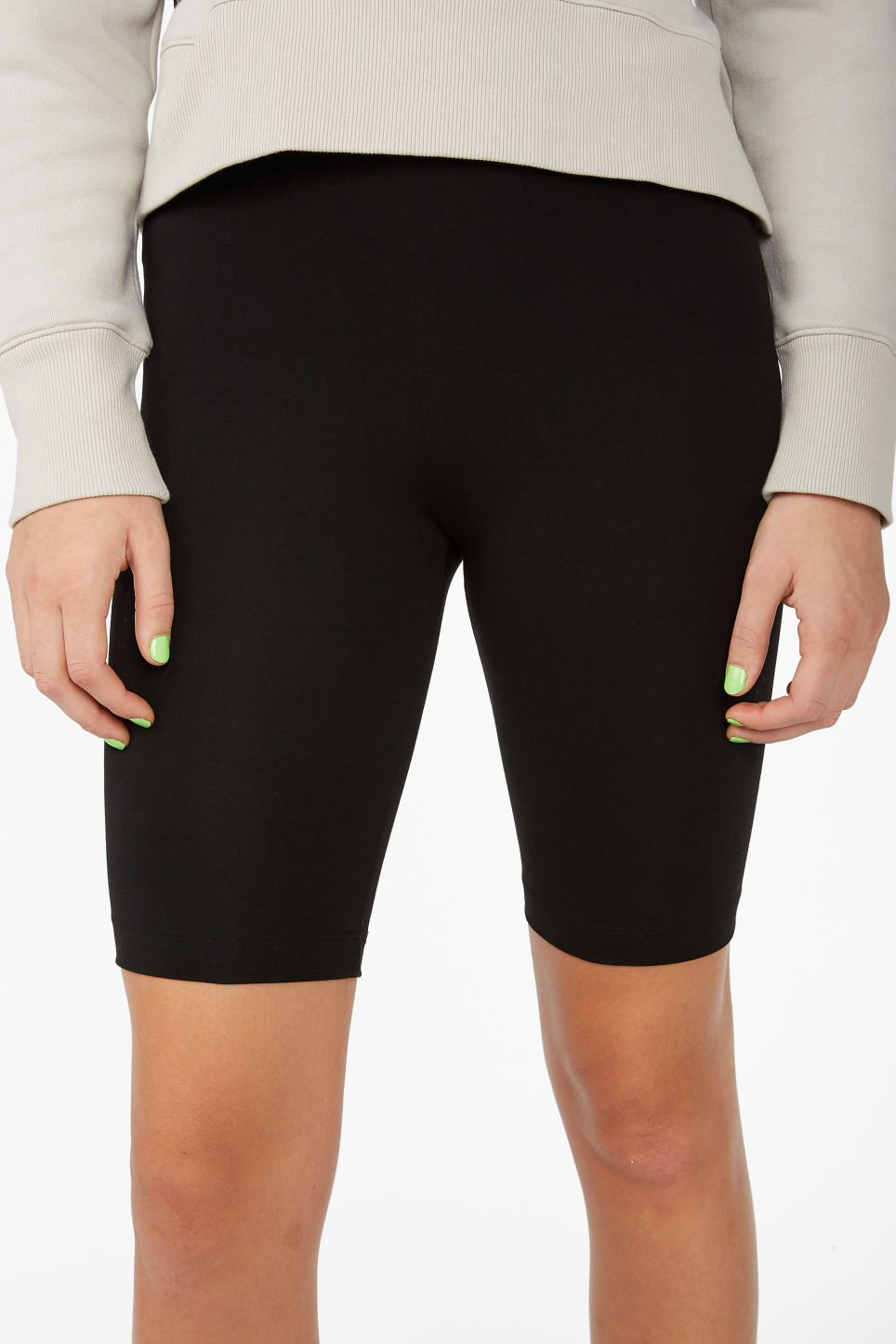 Model side image of Monki short leggings in black