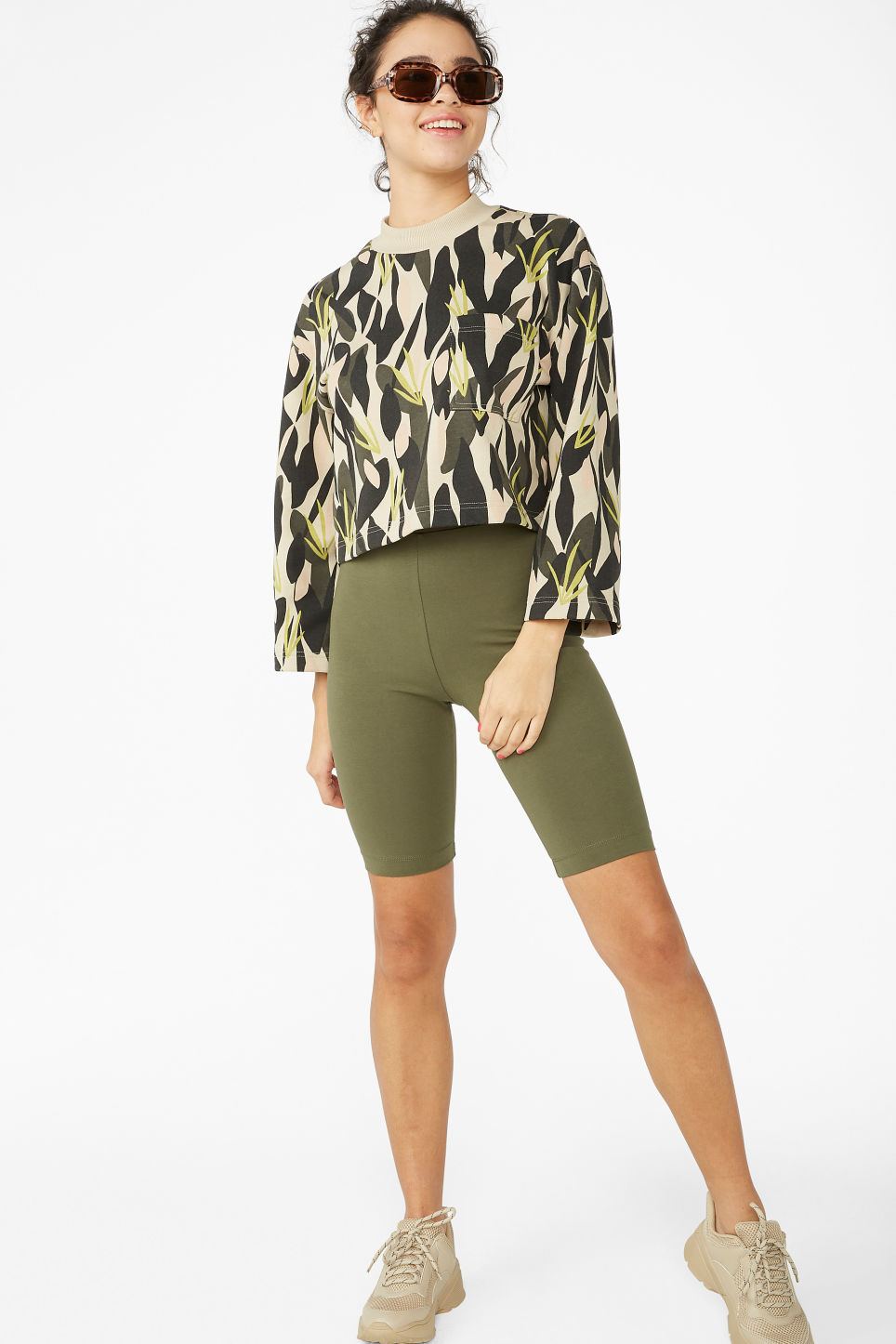 Model front image of Monki short leggings in green