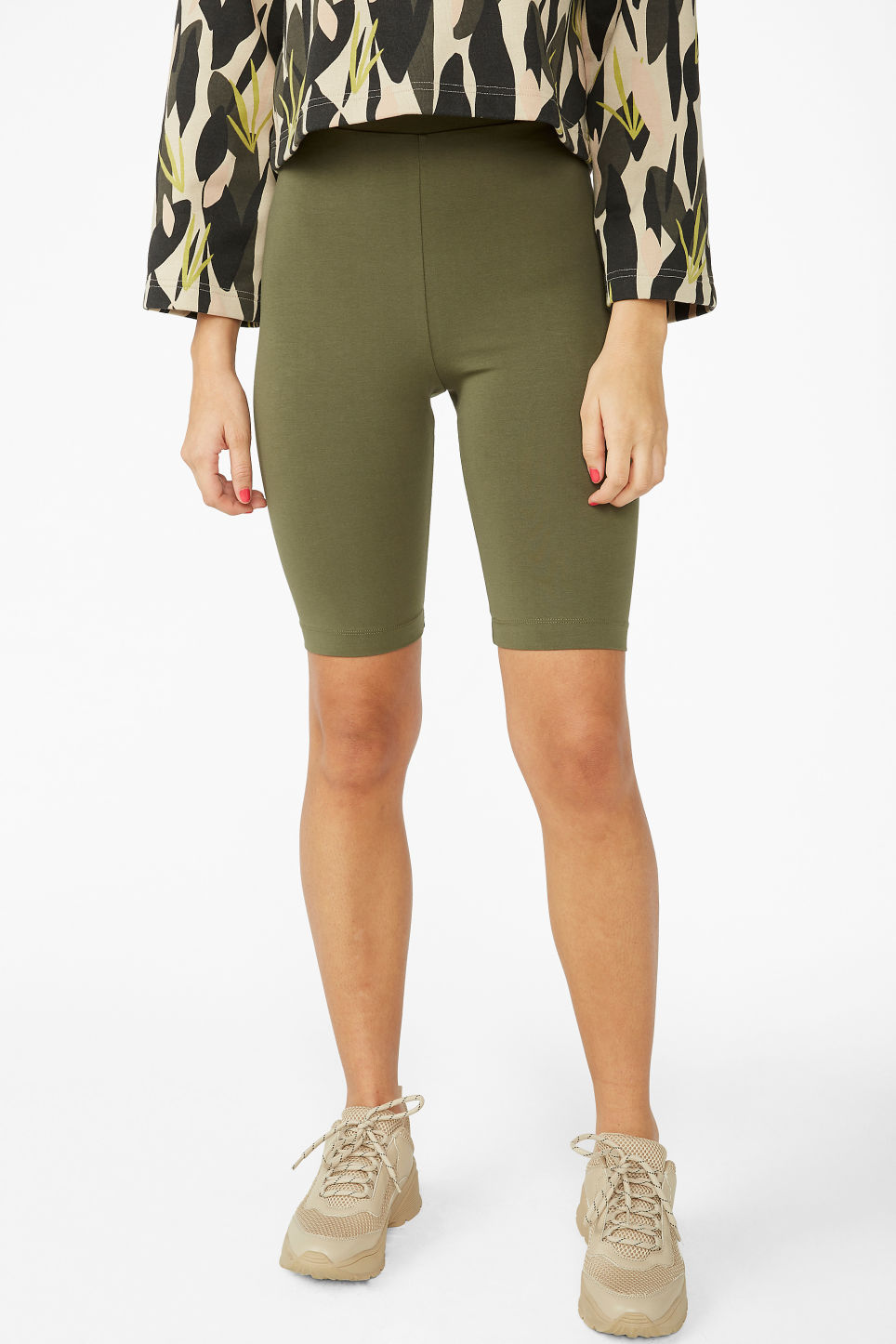 Model side image of Monki short leggings in green