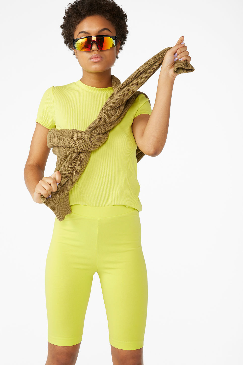 Model front image of Monki short leggings in yellow
