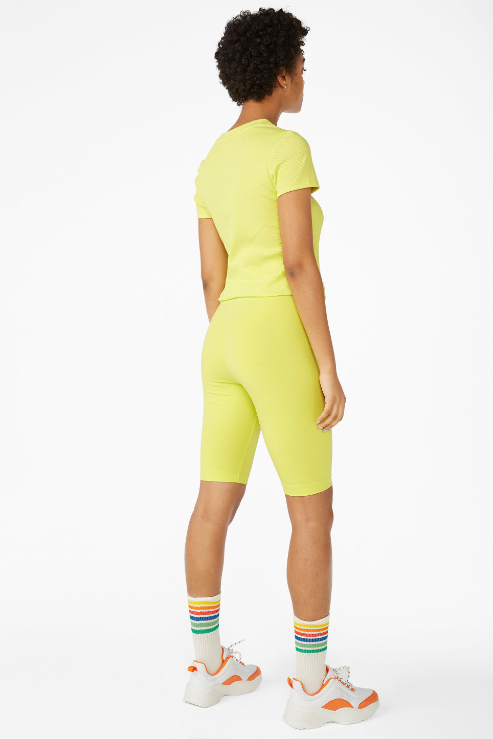Model back image of Monki short leggings in yellow