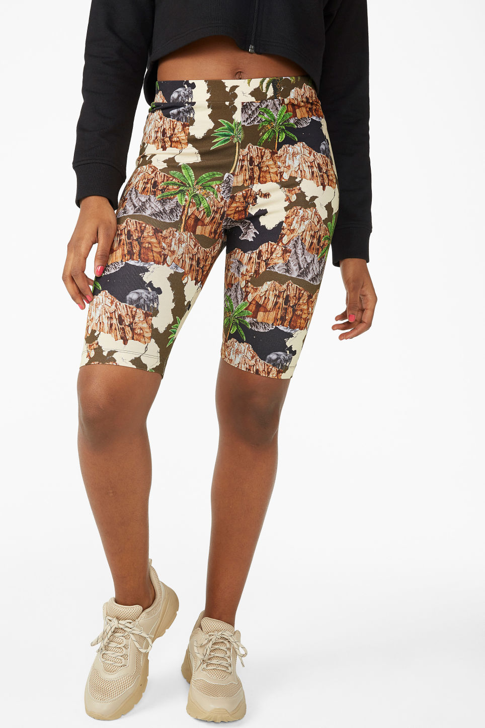 Model side image of Monki short leggings in orange