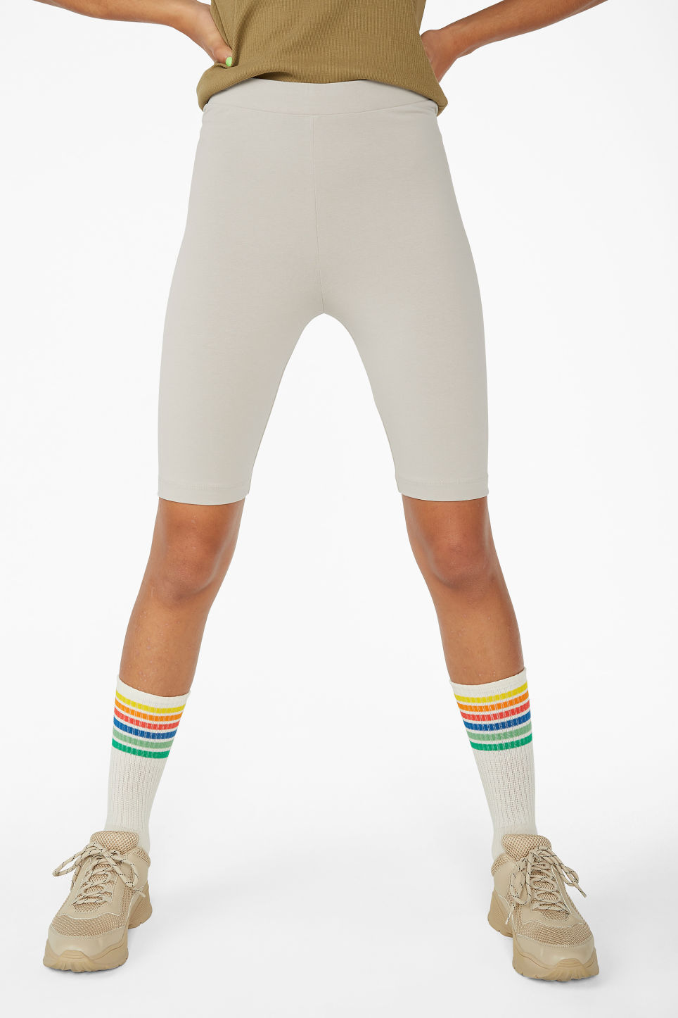 Model side image of Monki short leggings in brown