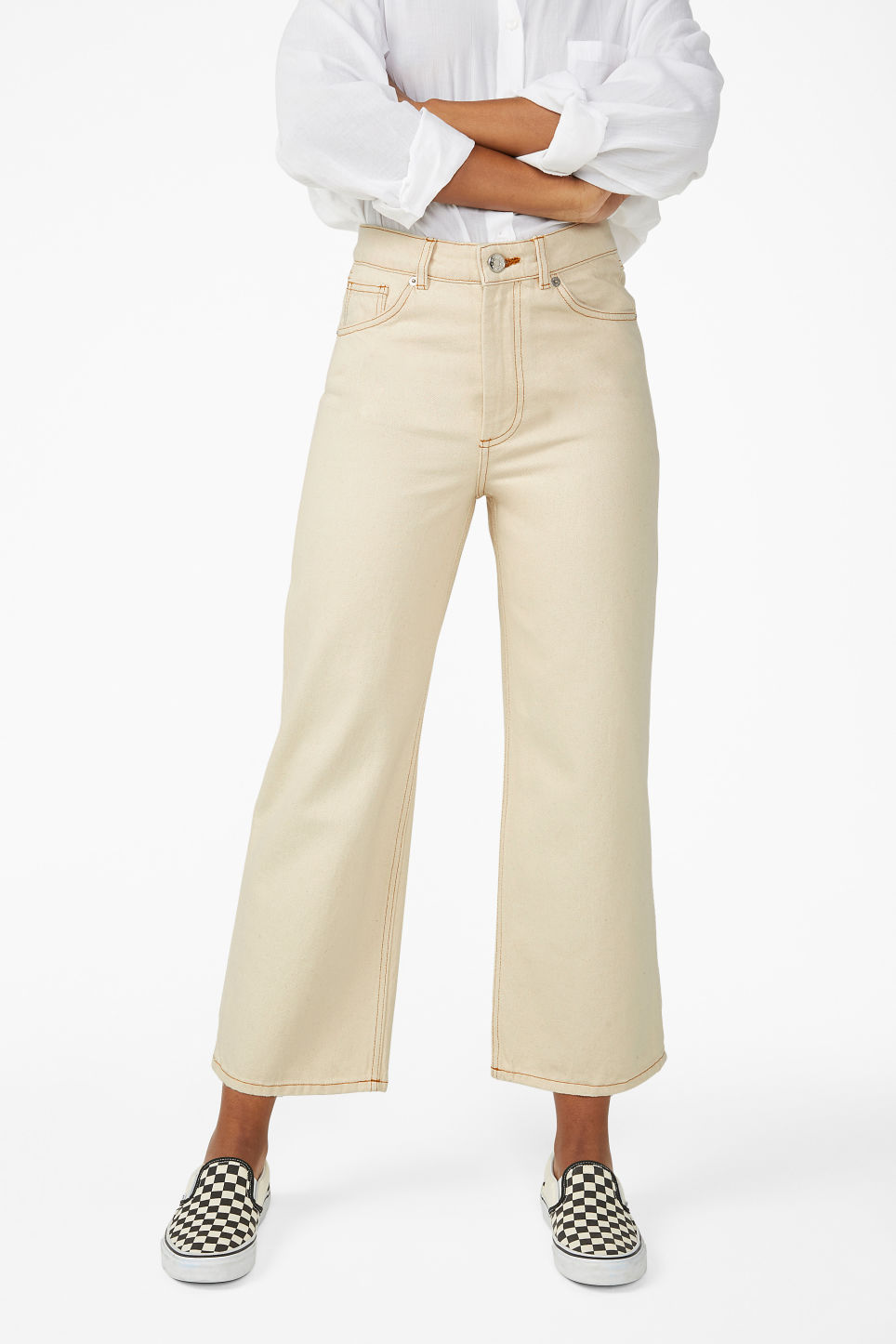 Model side image of Monki mozik off-white jeans in white