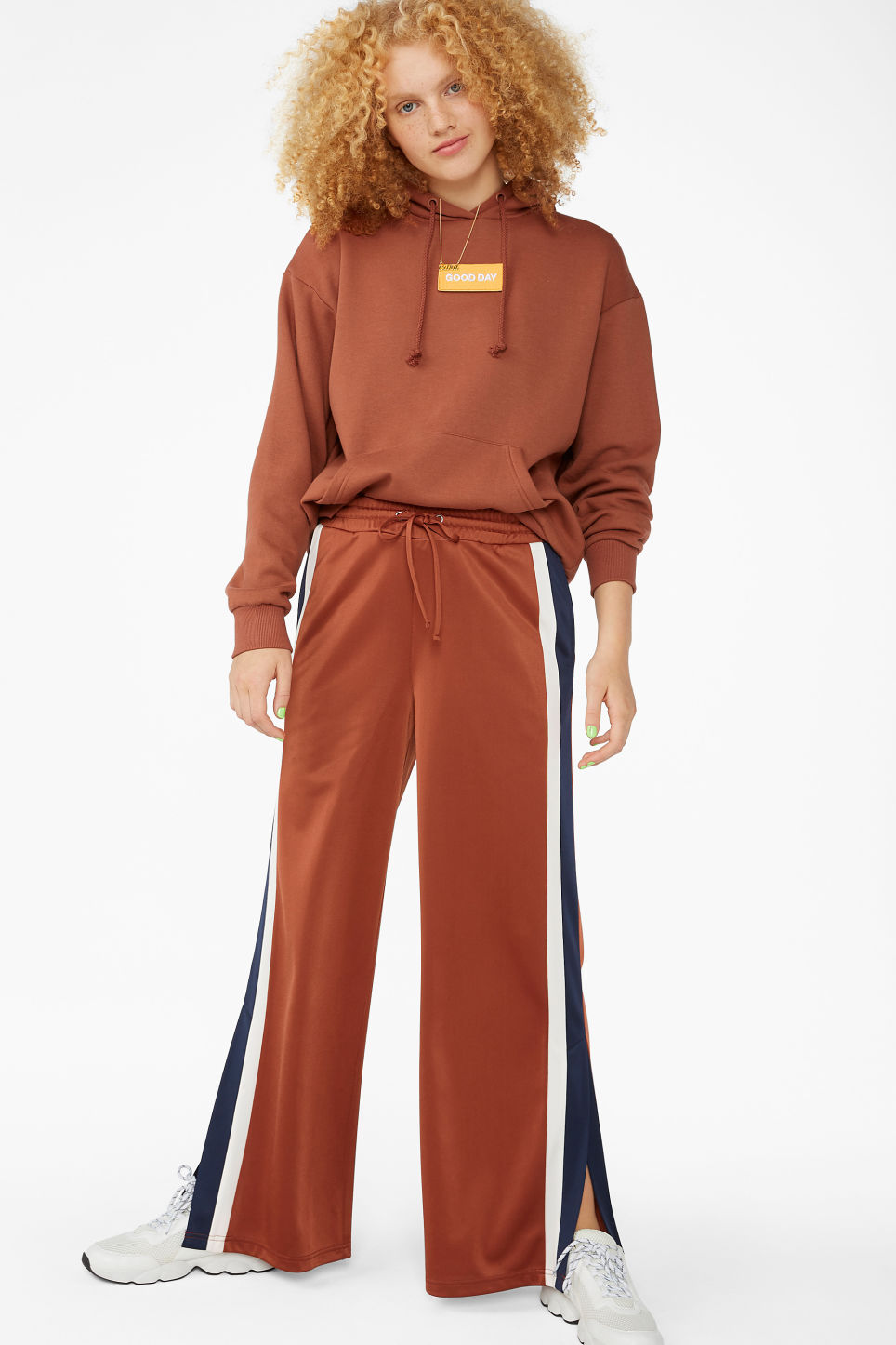 Model front image of Monki track pants in orange