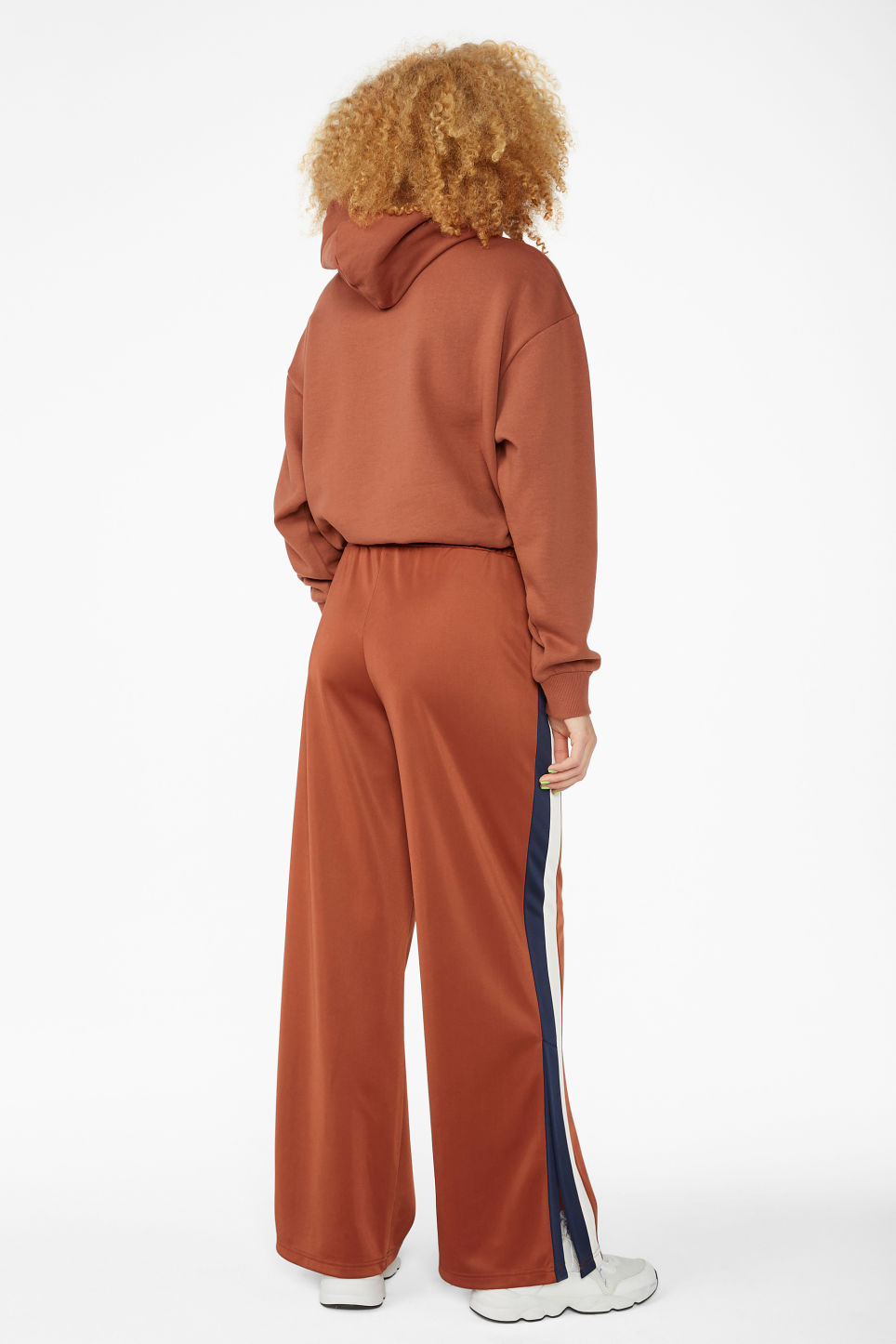 Model back image of Monki track pants in orange