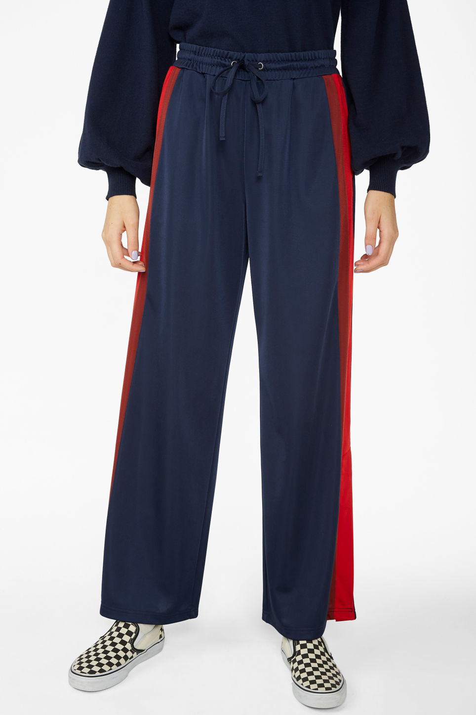 Model side image of Monki track pants in blue