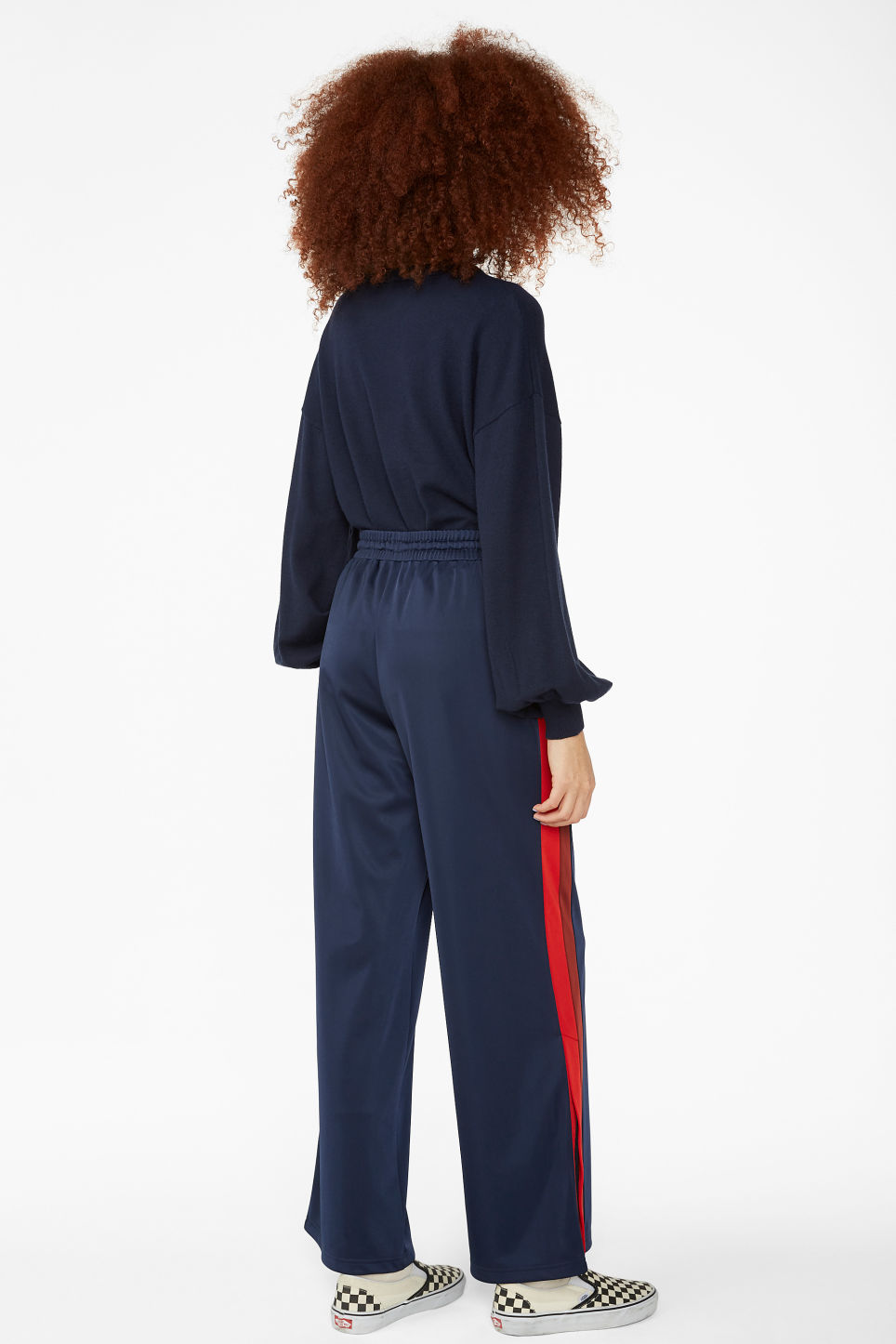 Model back image of Monki track pants in blue