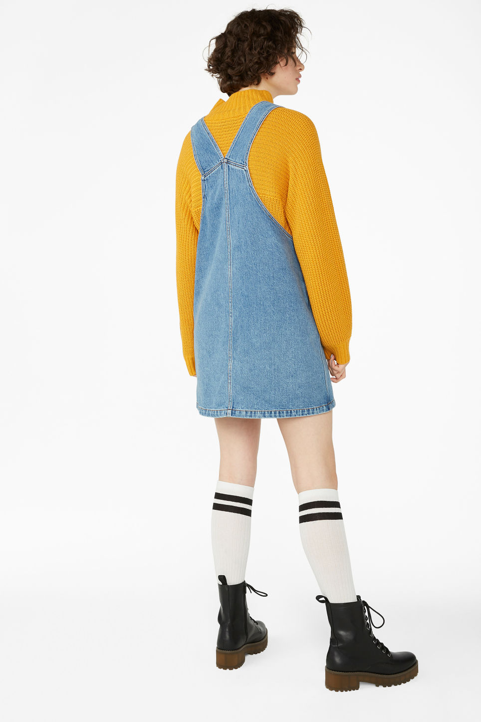 Model back image of Monki denim dungaree dress in blue