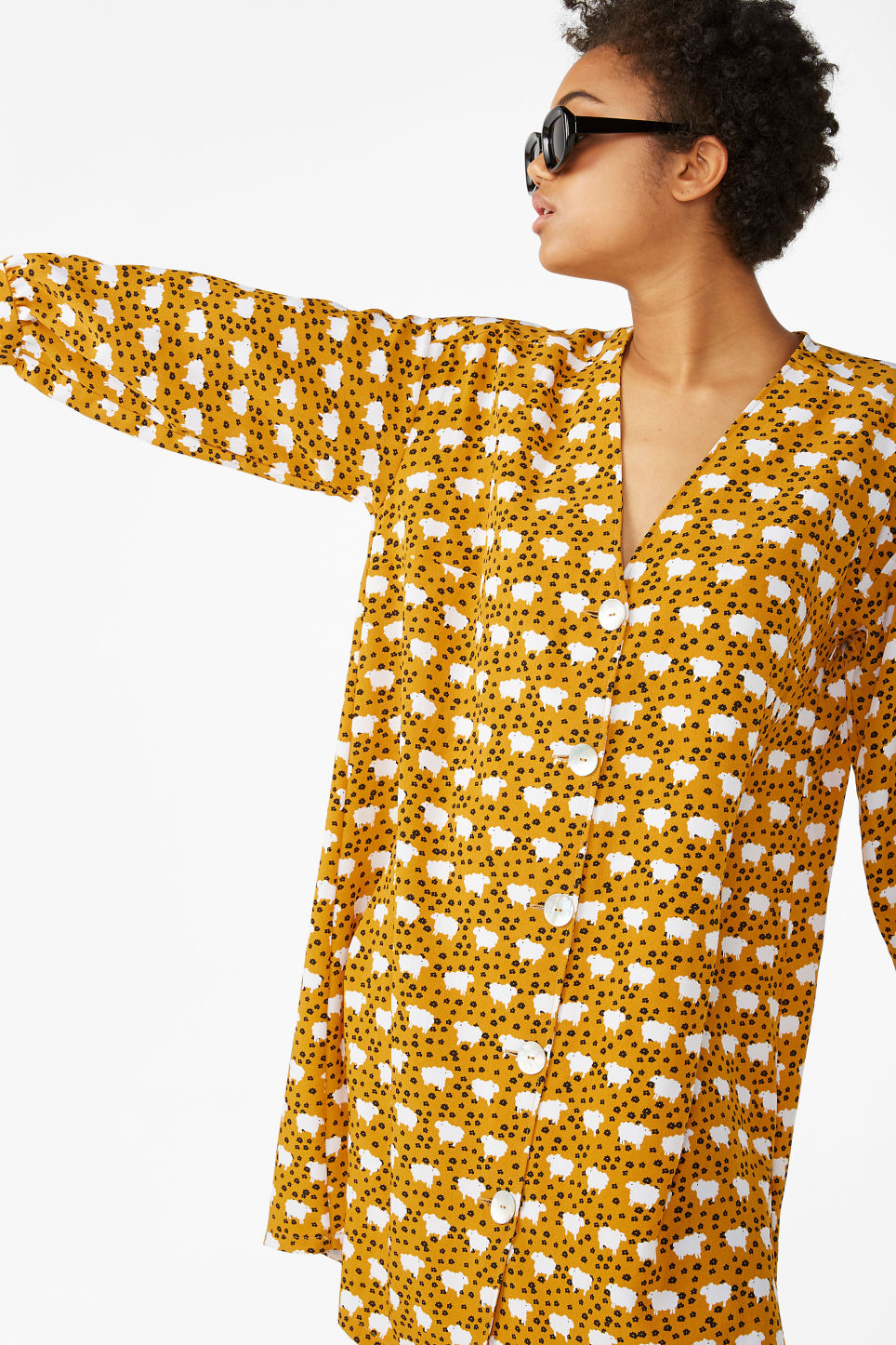 Model front image of Monki buttoned v-neck dress in yellow