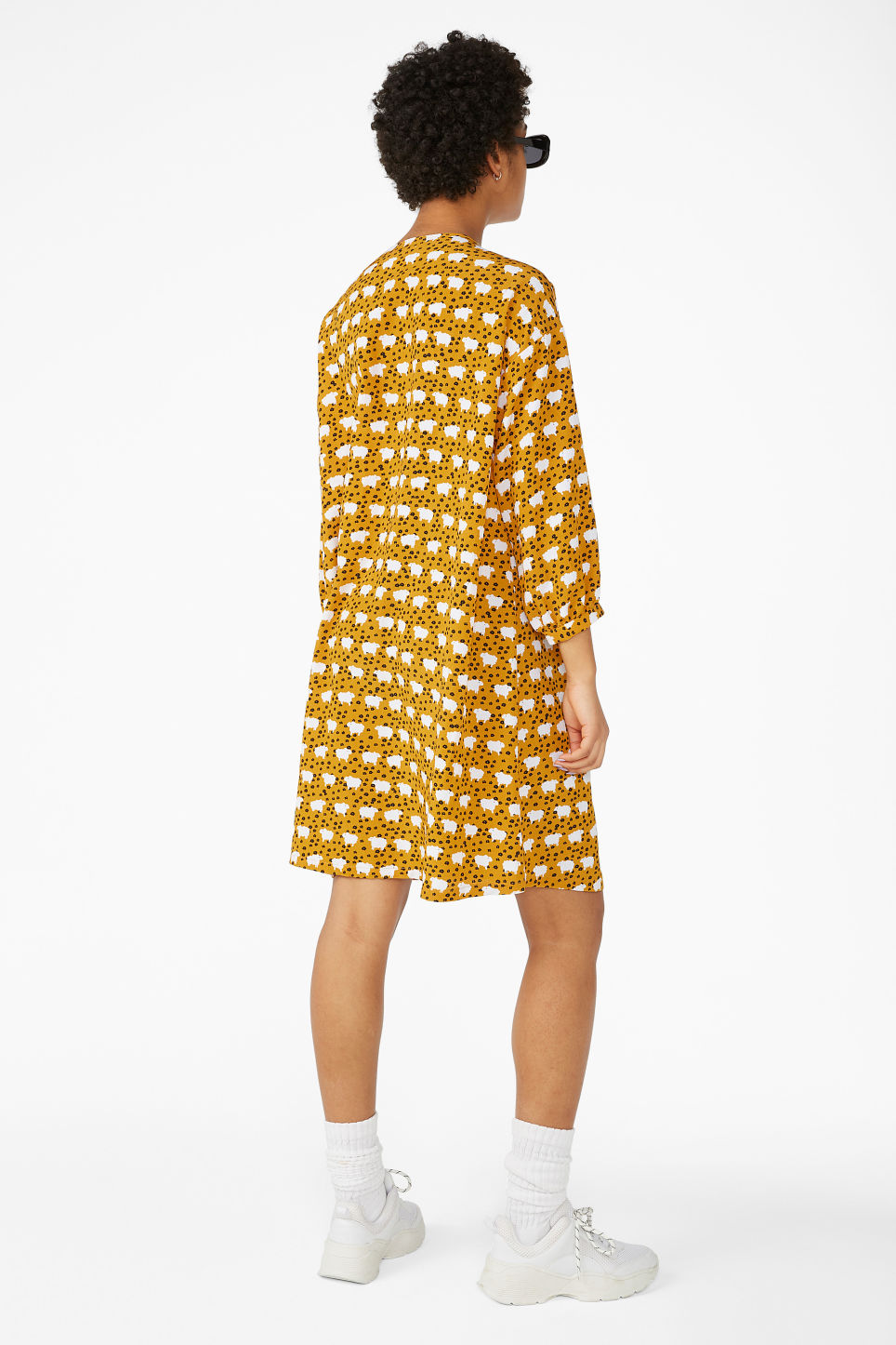 Model back image of Monki buttoned v-neck dress in yellow
