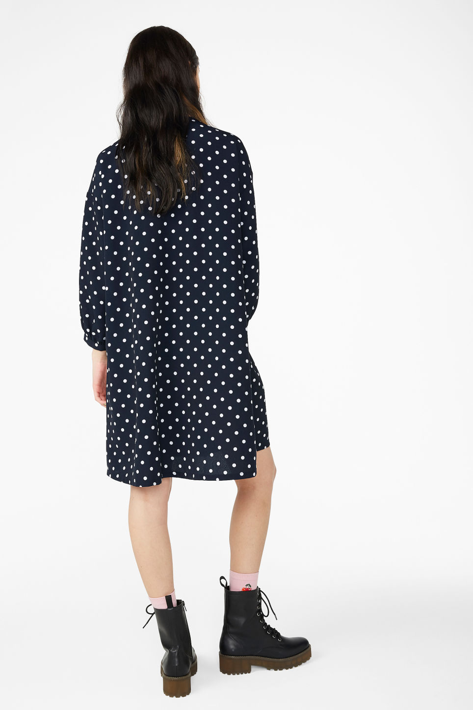 Model back image of Monki buttoned v-neck dress in blue