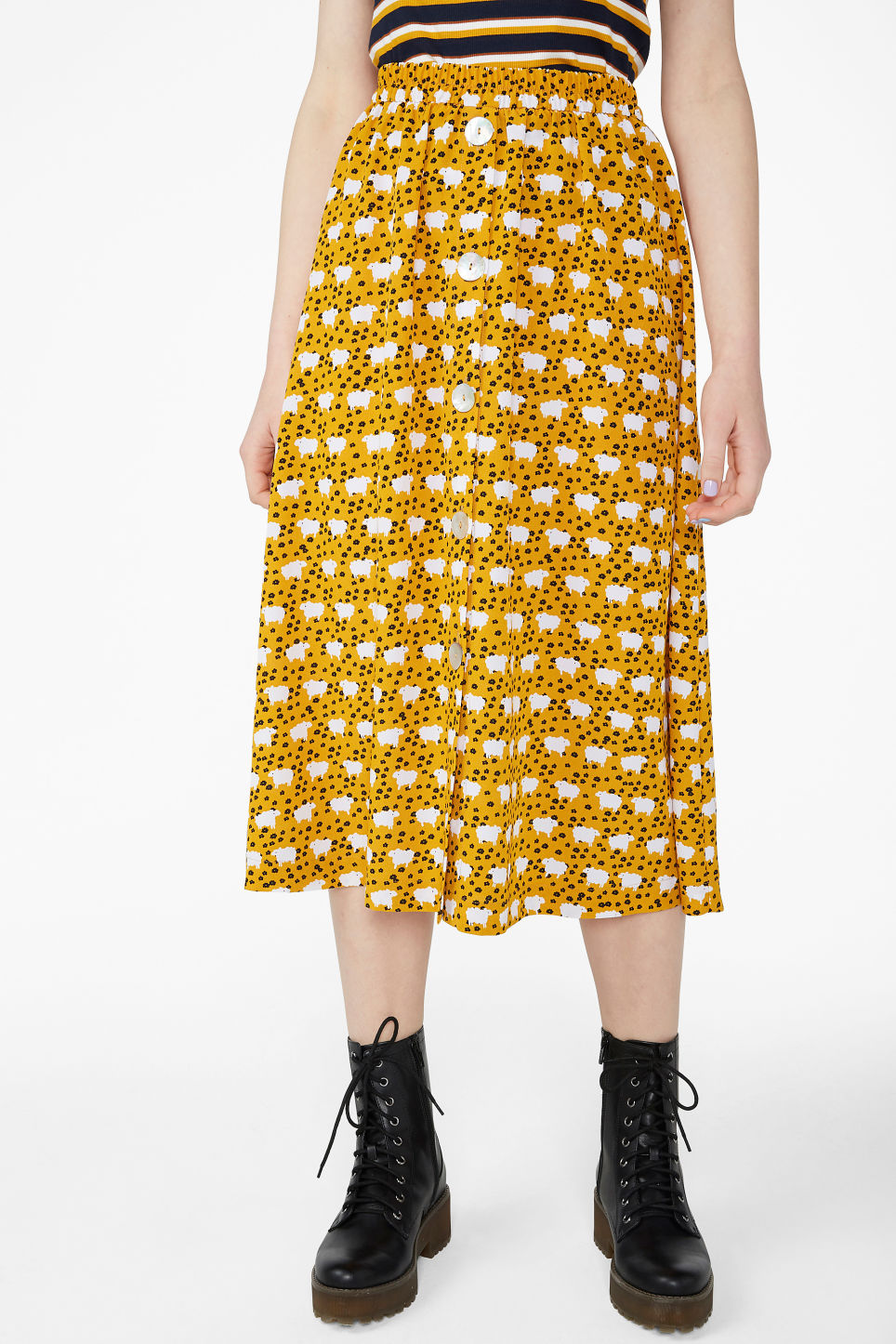 Model side image of Monki pearl effect button skirt in yellow