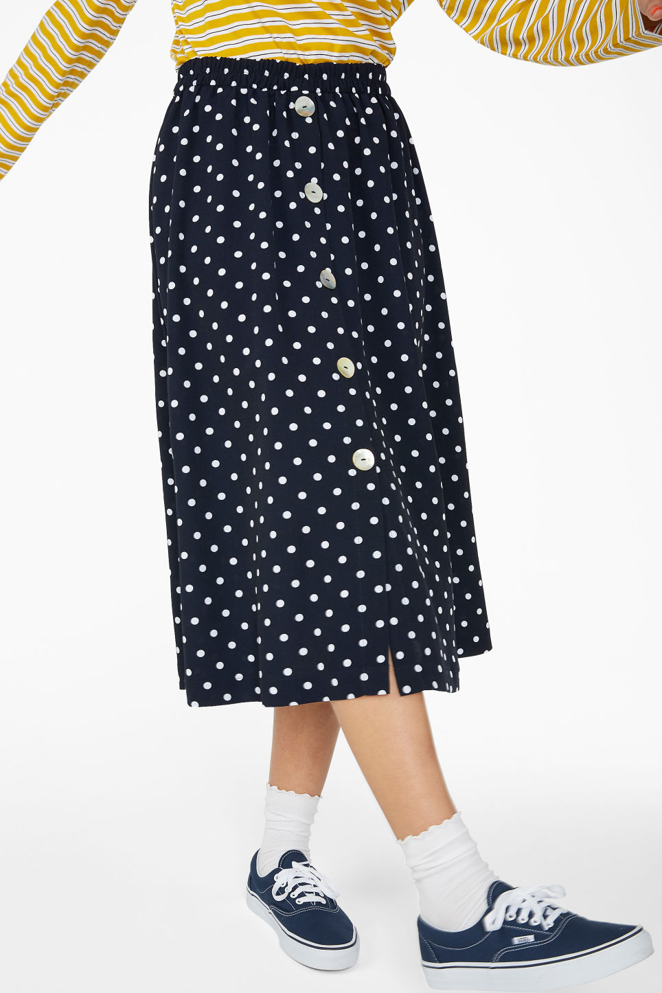 Model side image of Monki pearl effect button skirt in blue