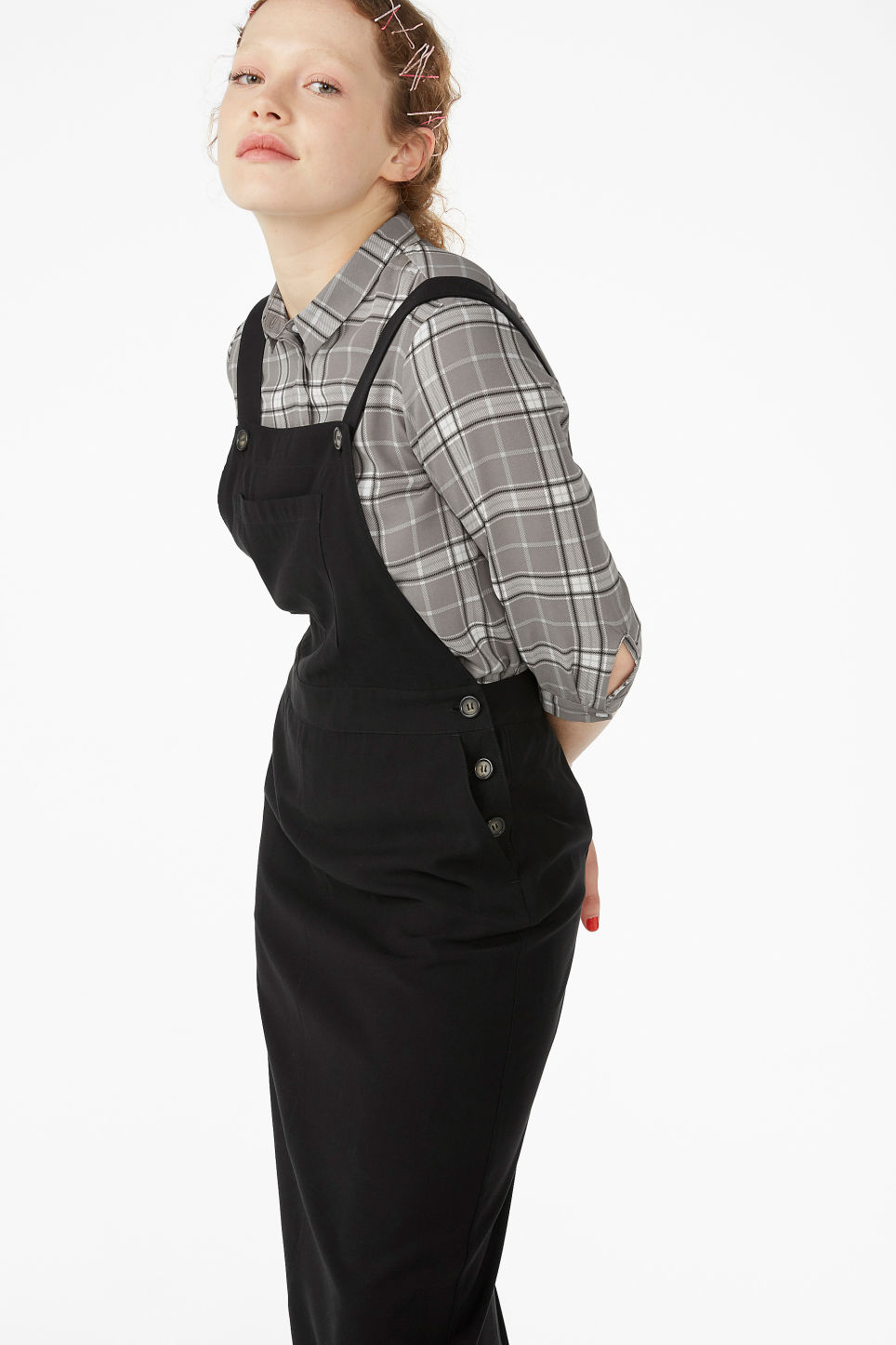 Model front image of Monki utility dungaree dress in black