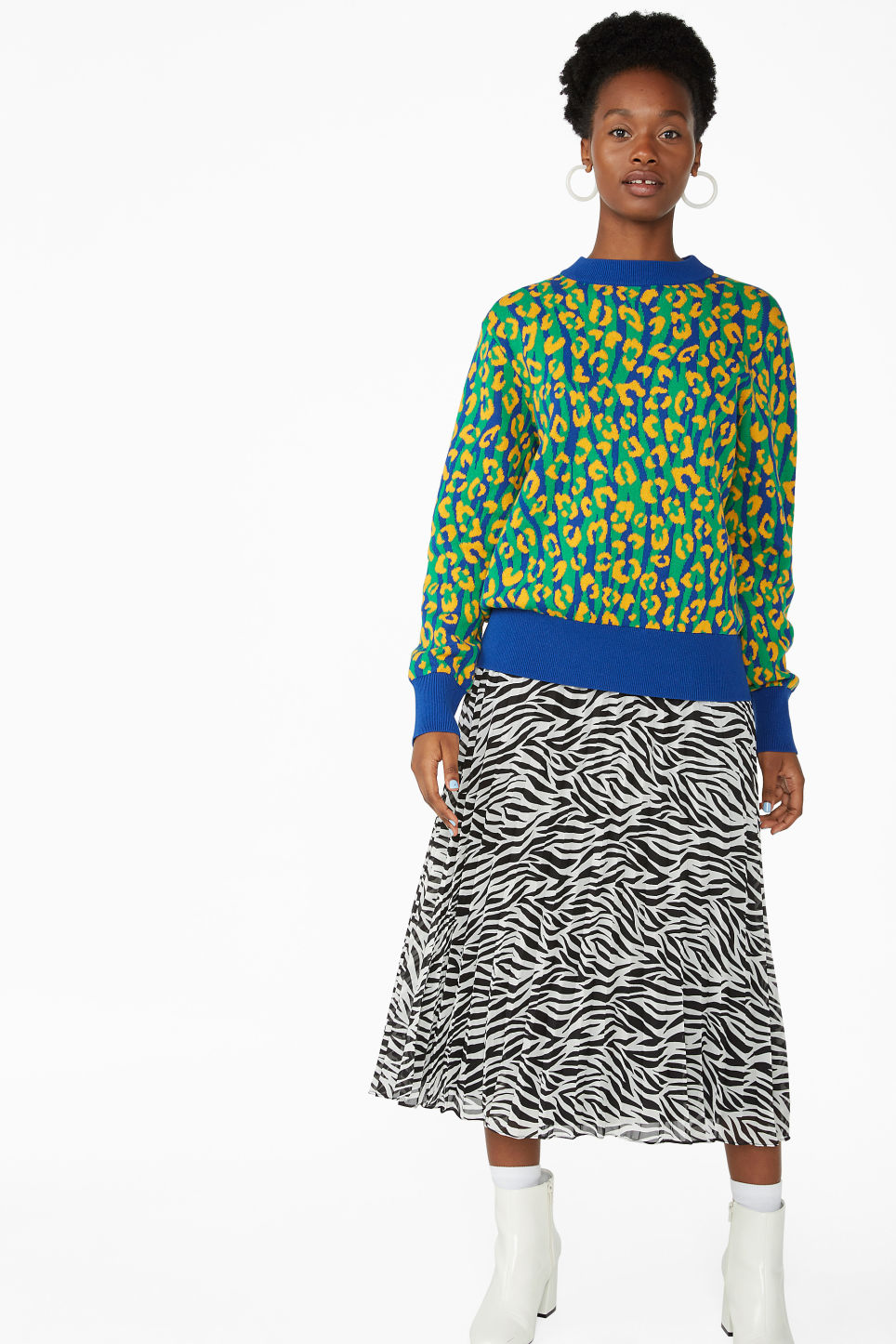 Model side image of Monki knitted sweater in blue
