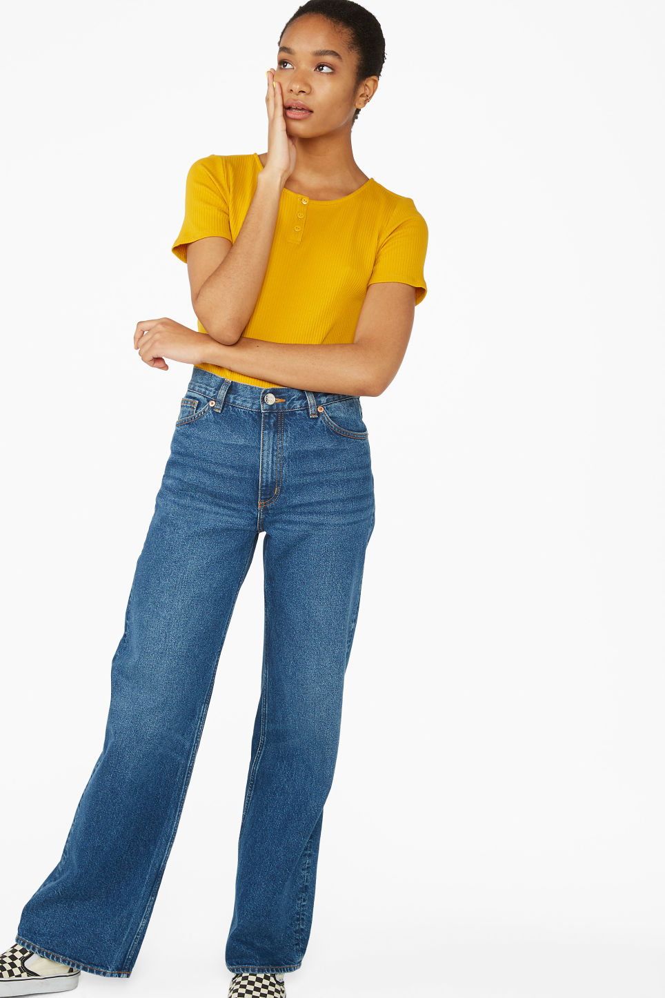 Model side image of Monki short-sleeved ribbed top in yellow