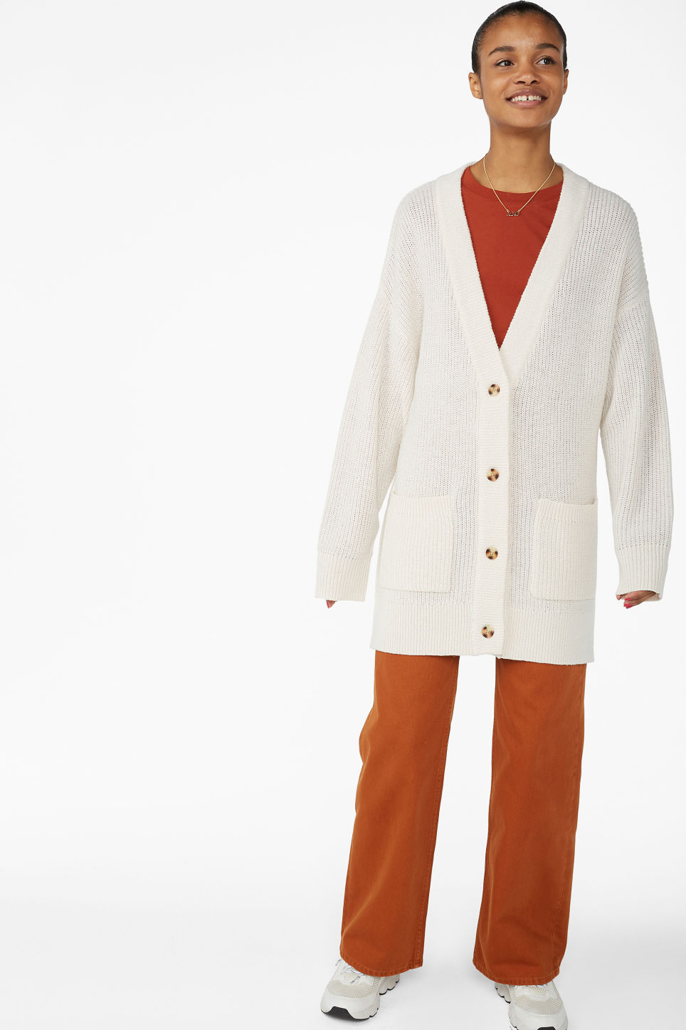 Model front image of Monki long knitted cardigan in white