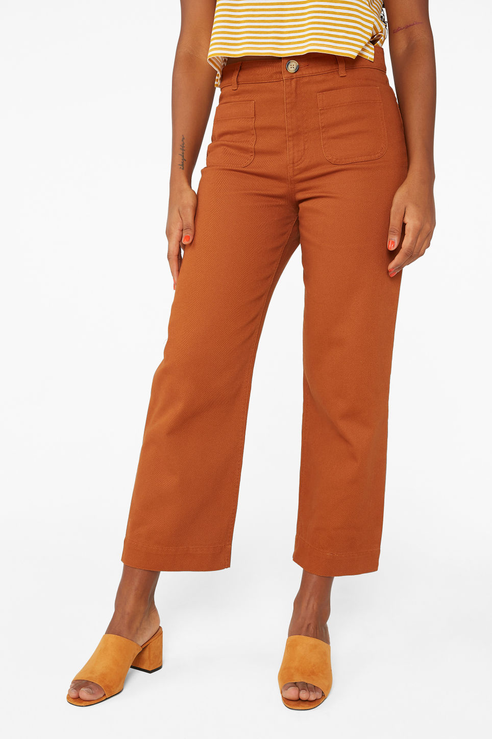 Model side image of Monki wide trousers in orange