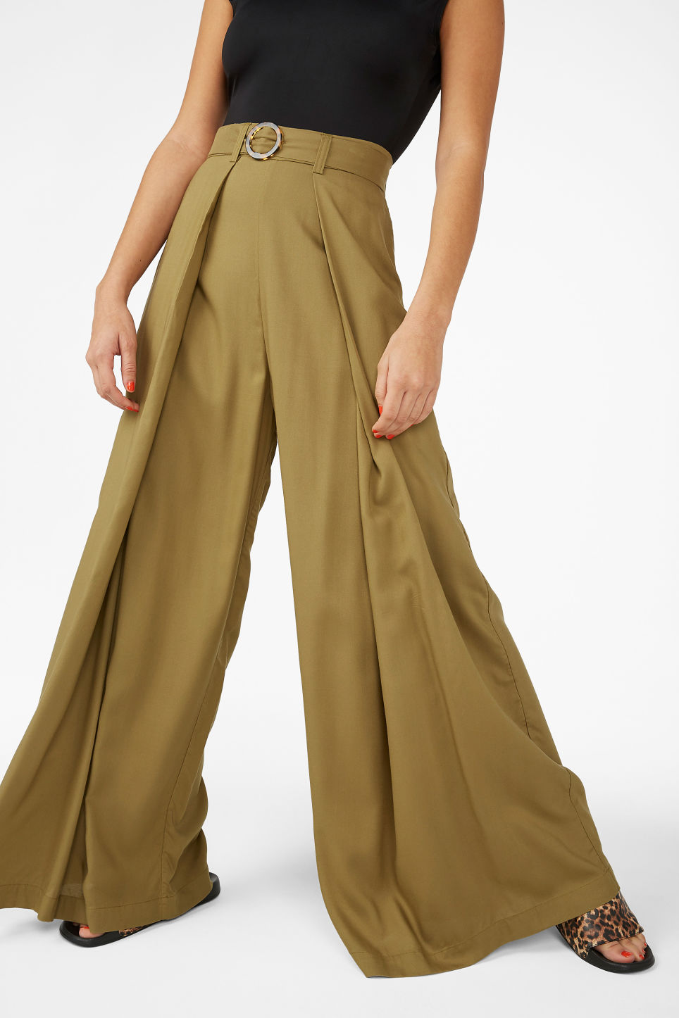 Model side image of Monki wrap style trousers in beige