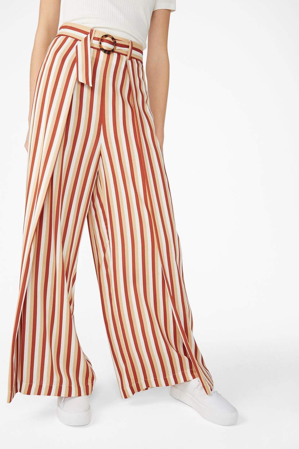 Model side image of Monki wrap style trousers in orange