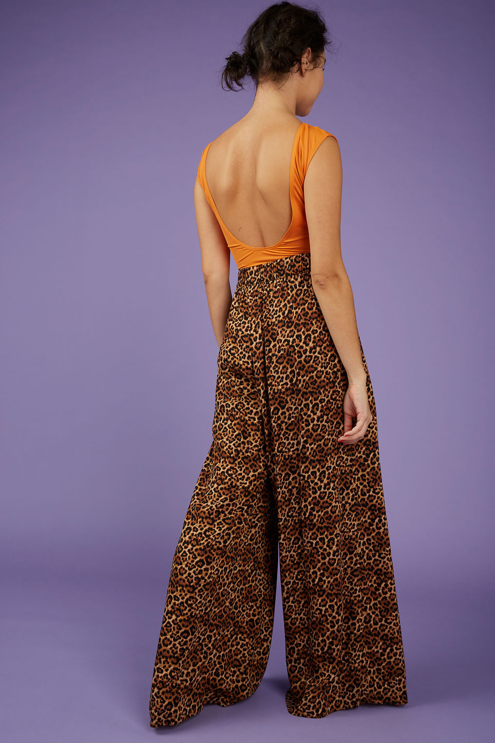 Model back image of Monki wrap style trousers in yellow