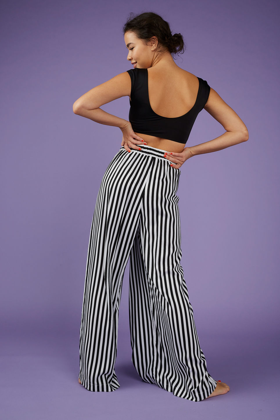 Model back image of Monki wrap style trousers in black