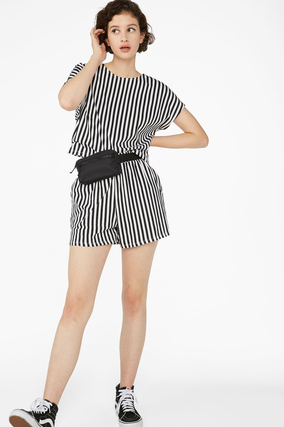 Model side image of Monki oversized back detail top in black