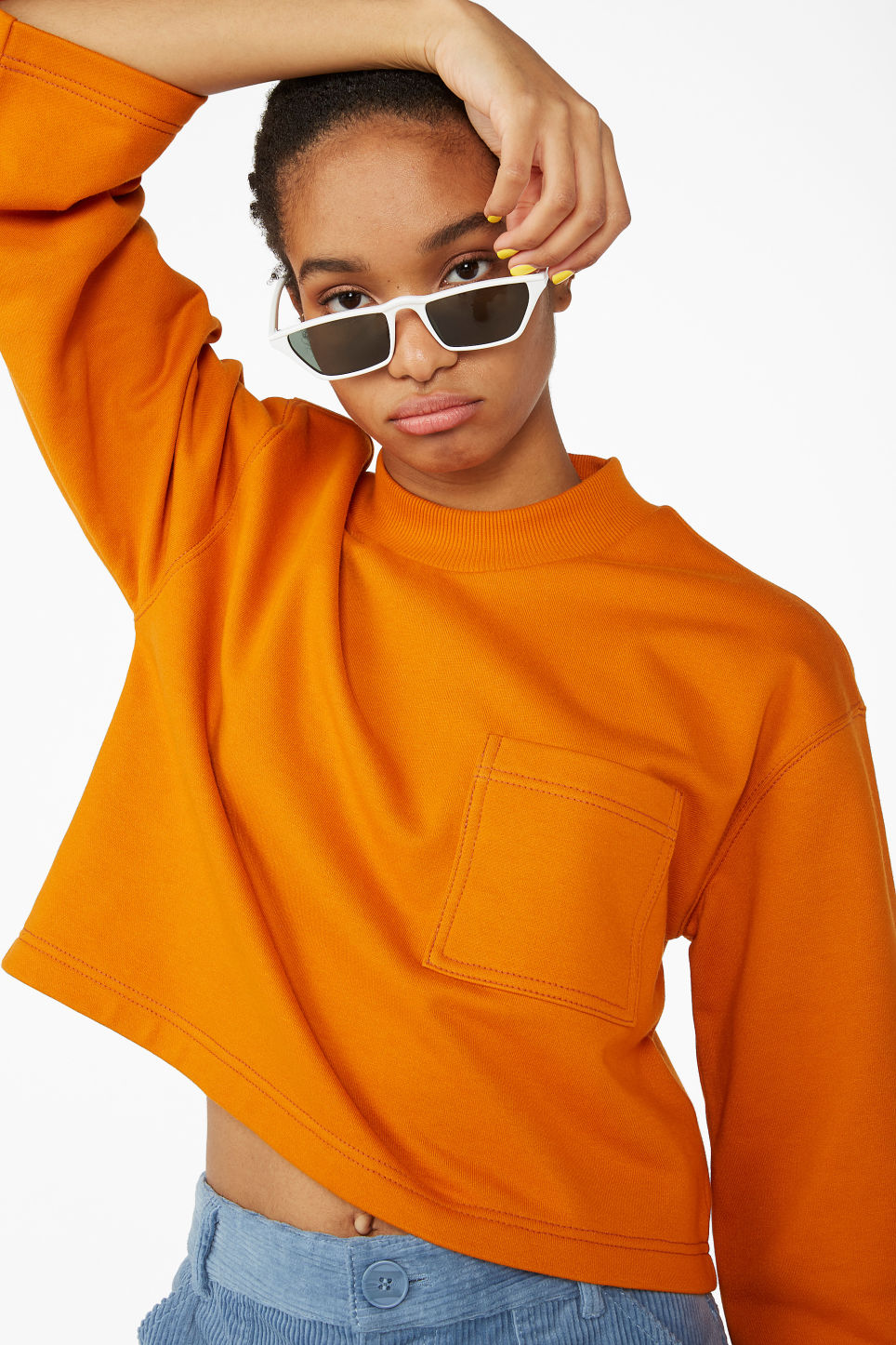 Model front image of Monki cropped sweater in orange