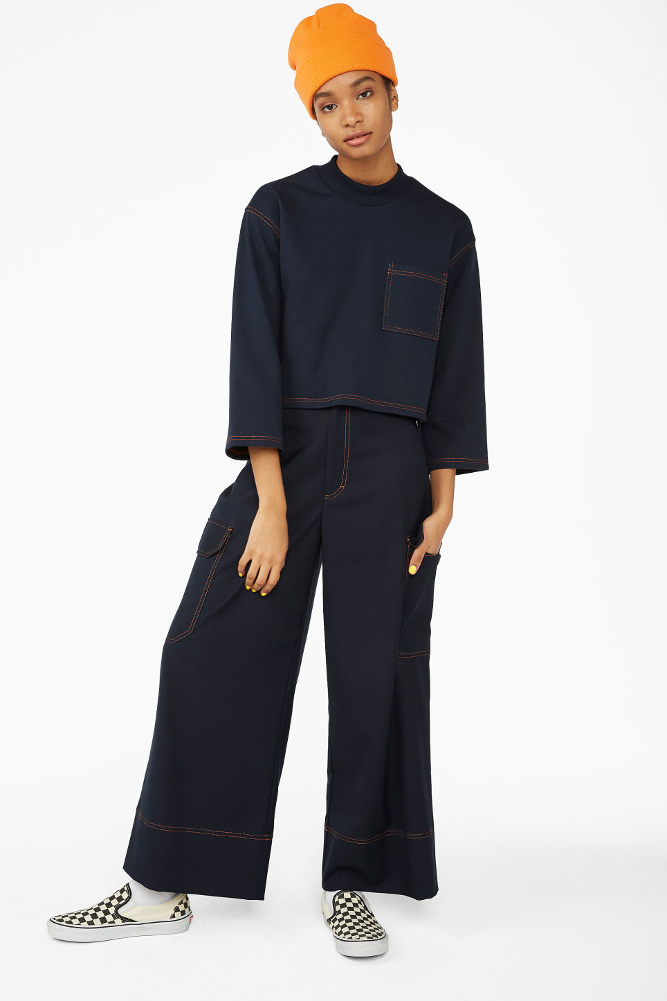 Model side image of Monki cropped sweater in blue