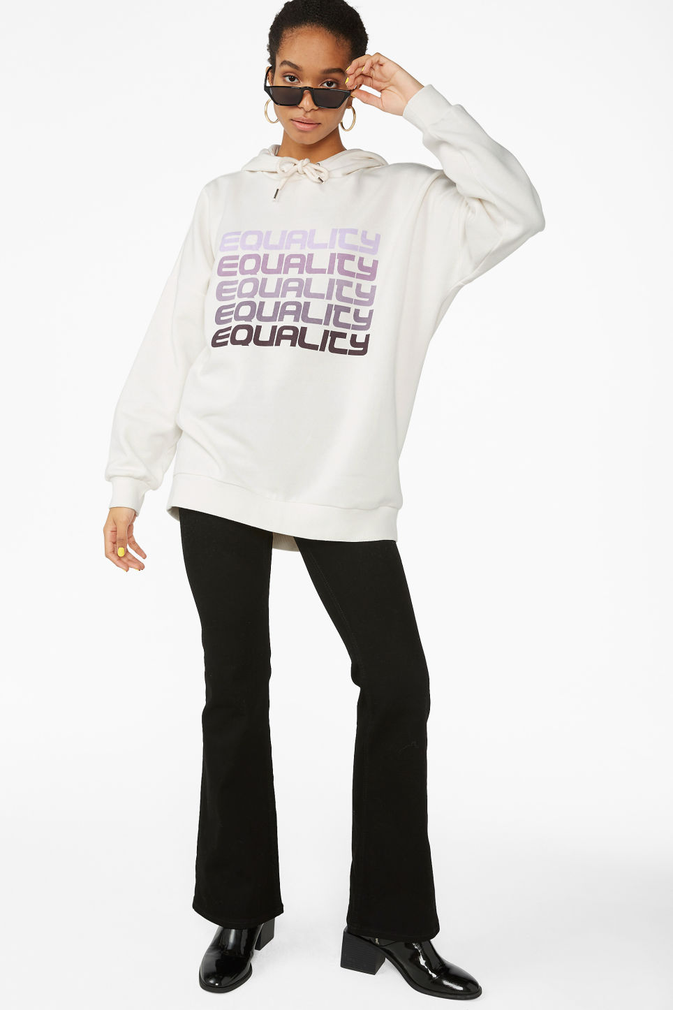 Model side image of Monki soft drawstring hoodie in white